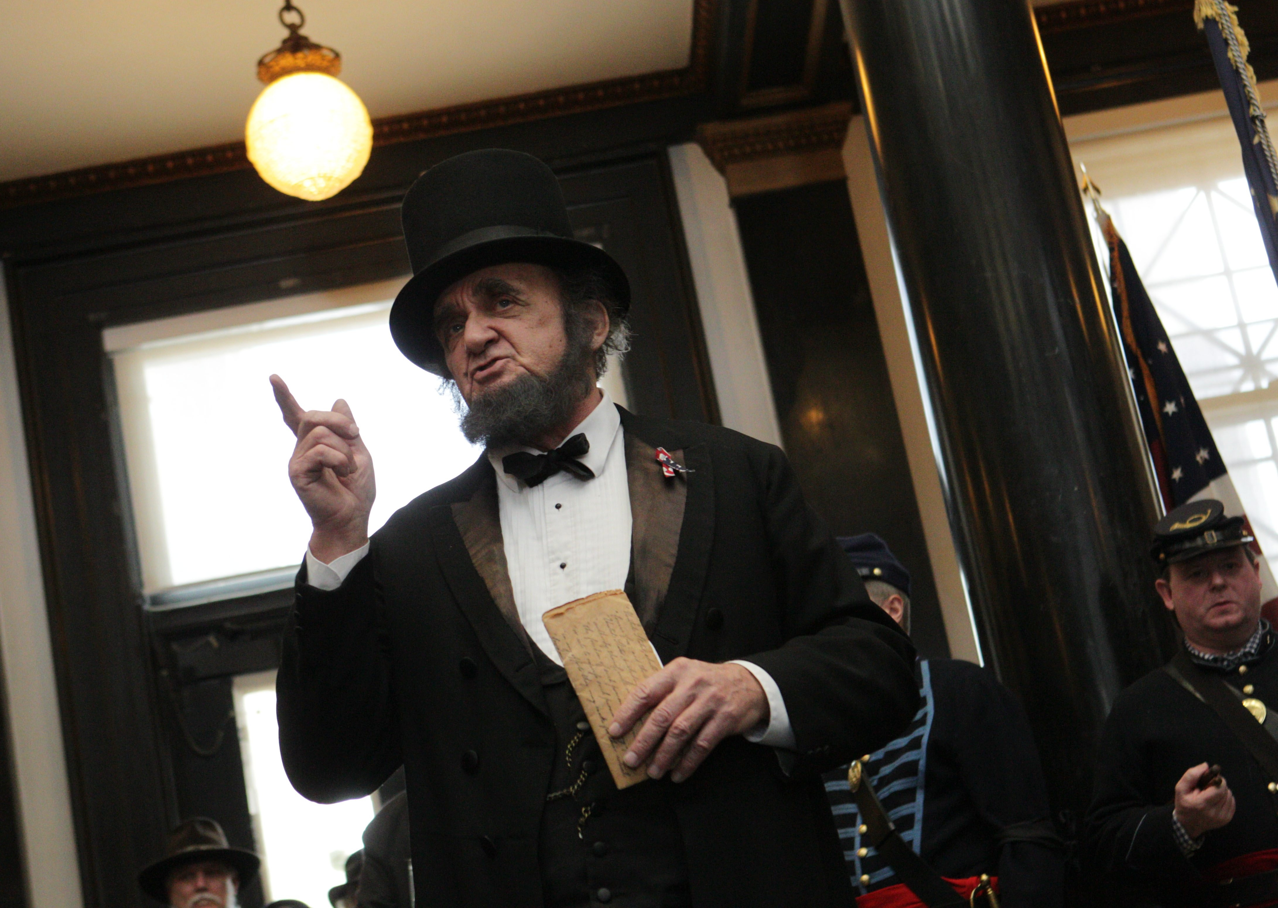 Lincoln re-enactor David Kreutz recites the Gettysburg Address for the crowd assembled in the Buffalo History Museum's central court.