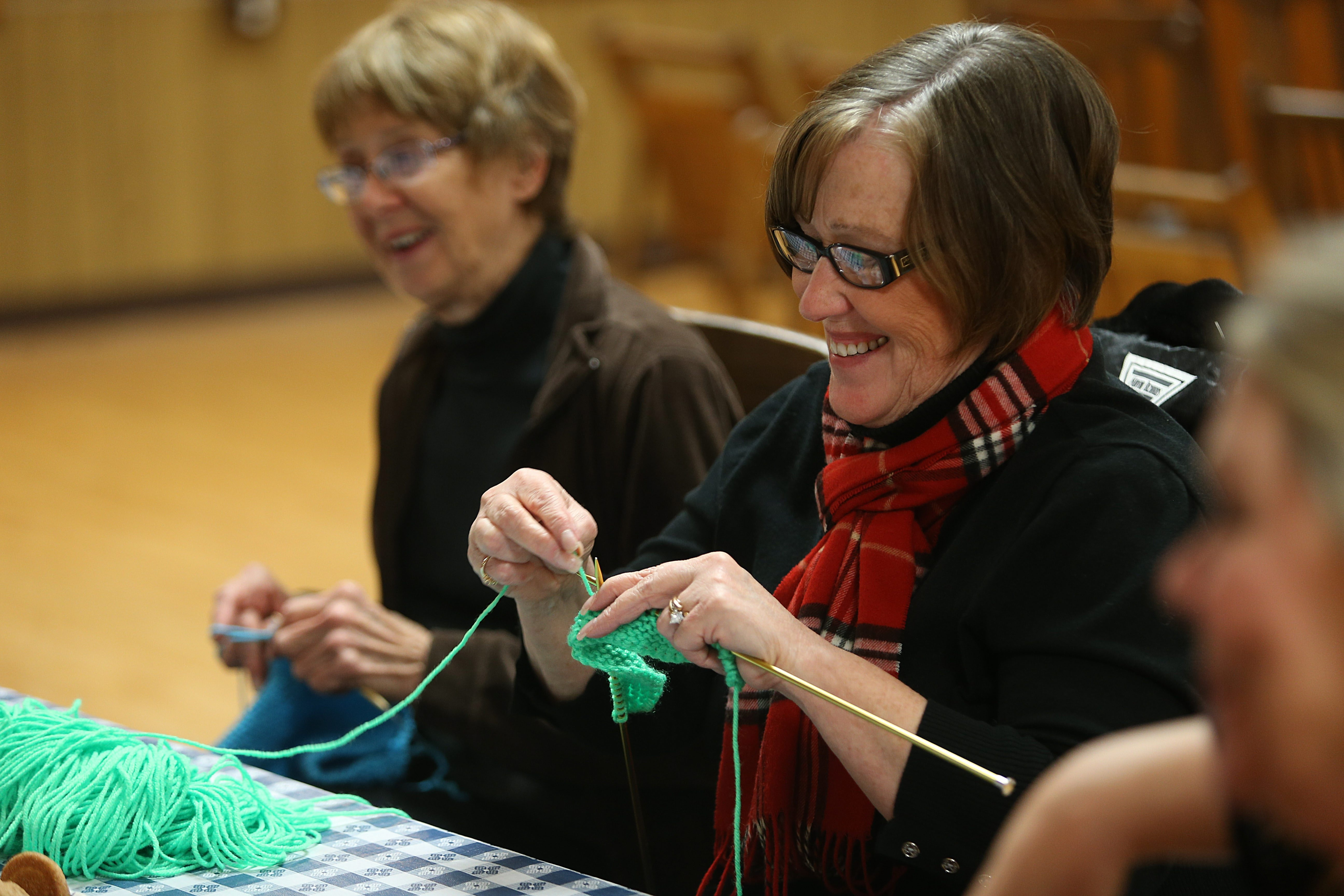 Linda Parlato, left, and Jayne Brasser find a lot to like at the Knit Wits monthly knitting group. It meets in the historic Old Lewiston Opera Hall at 732 Center St.