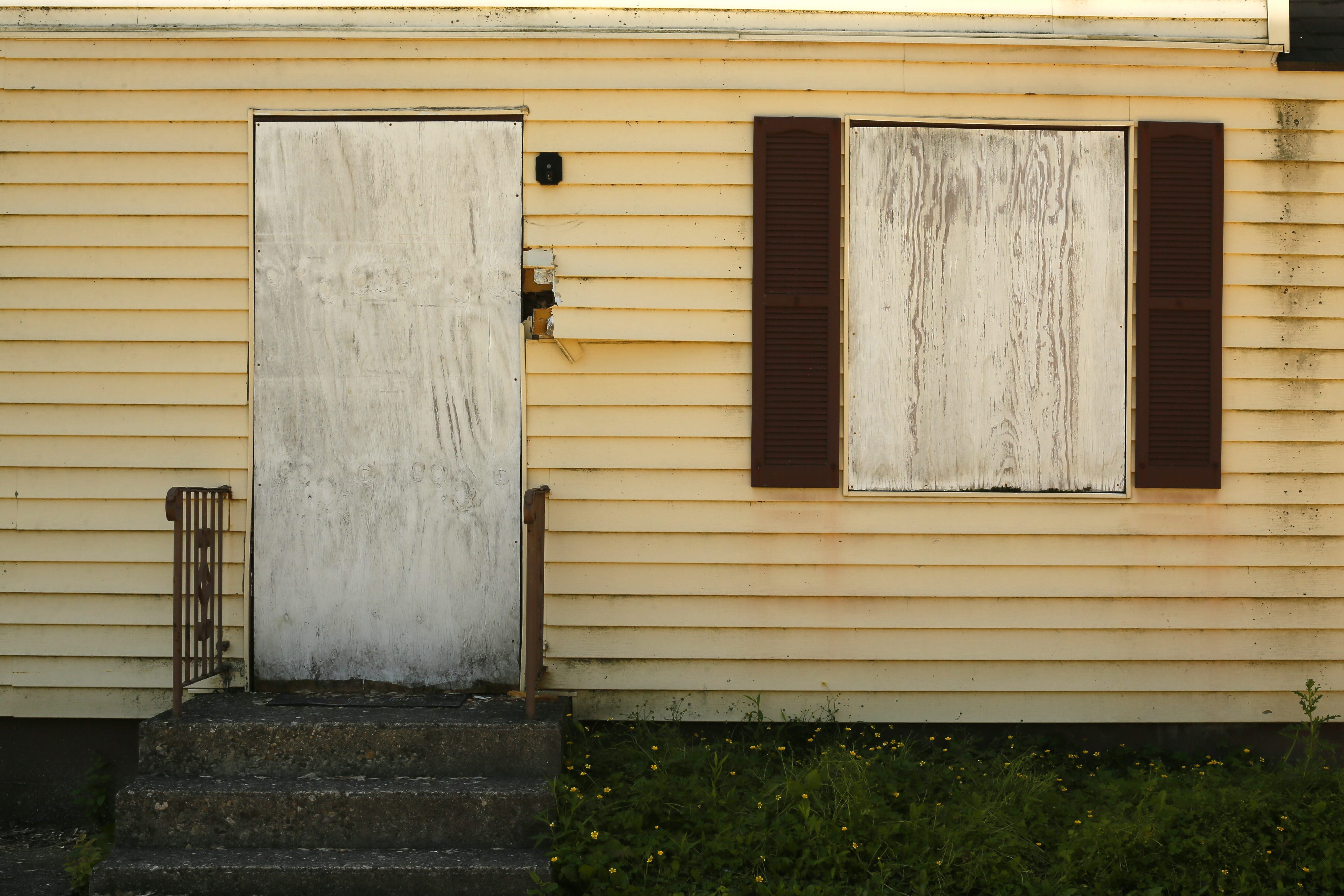 """Zombie"" homes deteriorate for years and become an unsightly drag on neighborhoods."