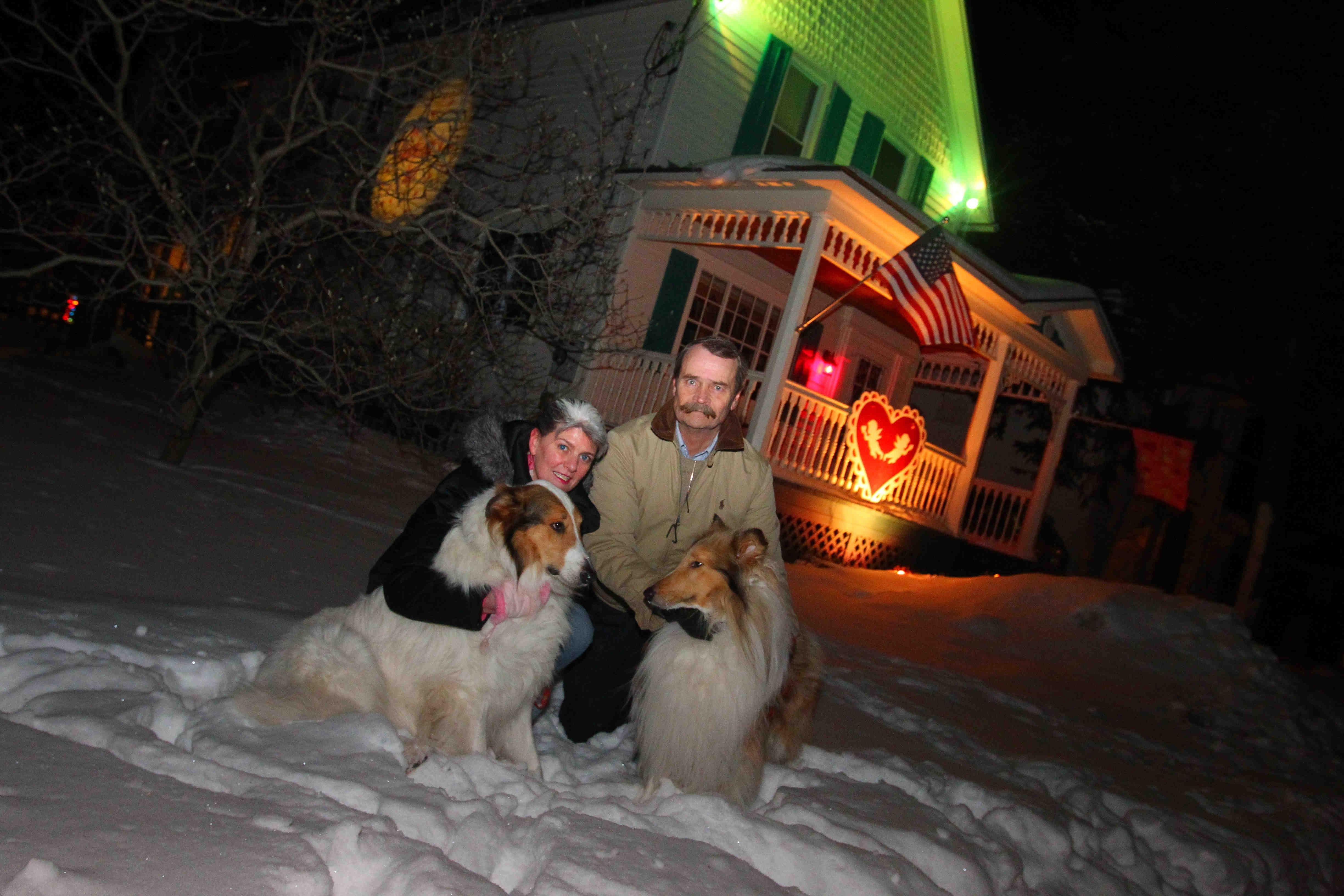 Paul and Mary Lynne Clough pose outside their Valentine's Day-festooned  house in the East Aurora. The house is decorated for every major holiday, but this one is something special.