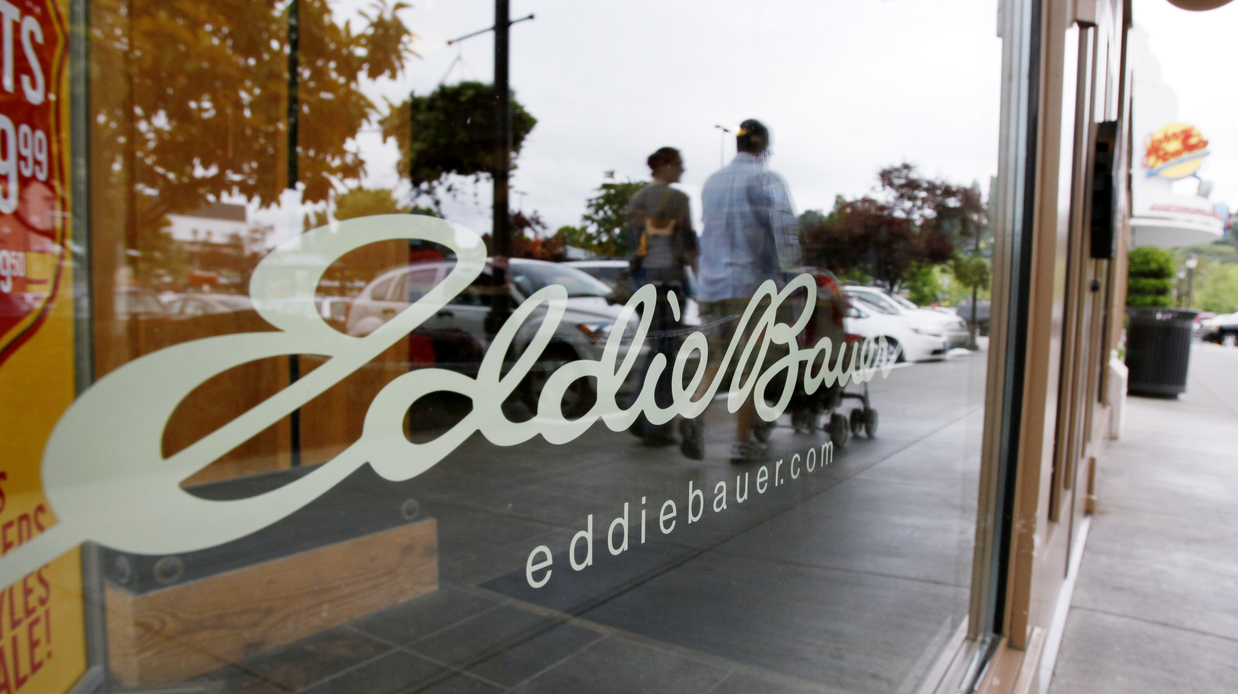 Jos. A. Bank Clothiers Inc. says it is buying the parent company of Eddie Bauer in a cash-and-stock deal valued at $825 million.