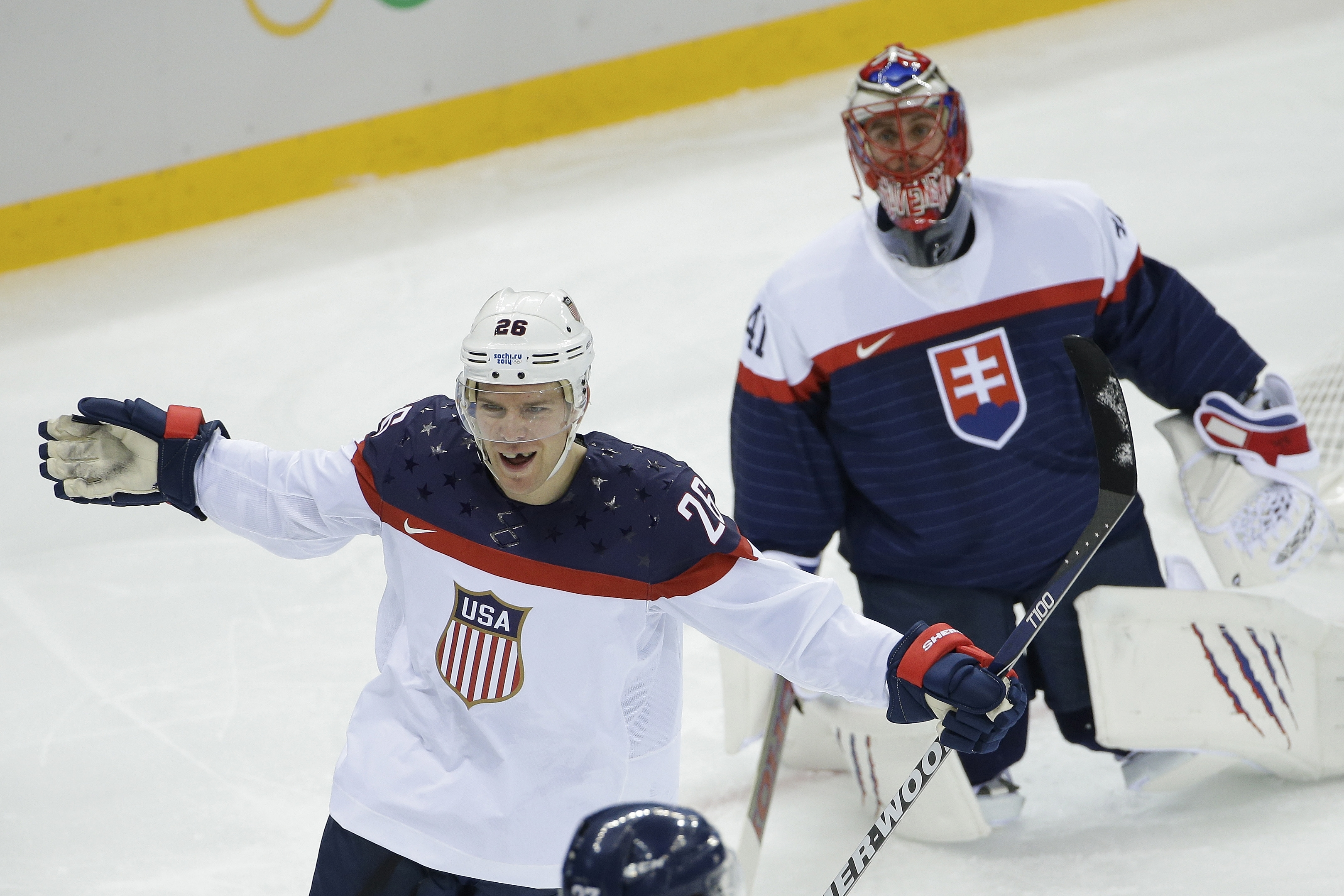 Paul Stastny celebrates his goal as the Slovakian goalie looks on at Shayba Arena in Sochi, Russia, on Thursday.