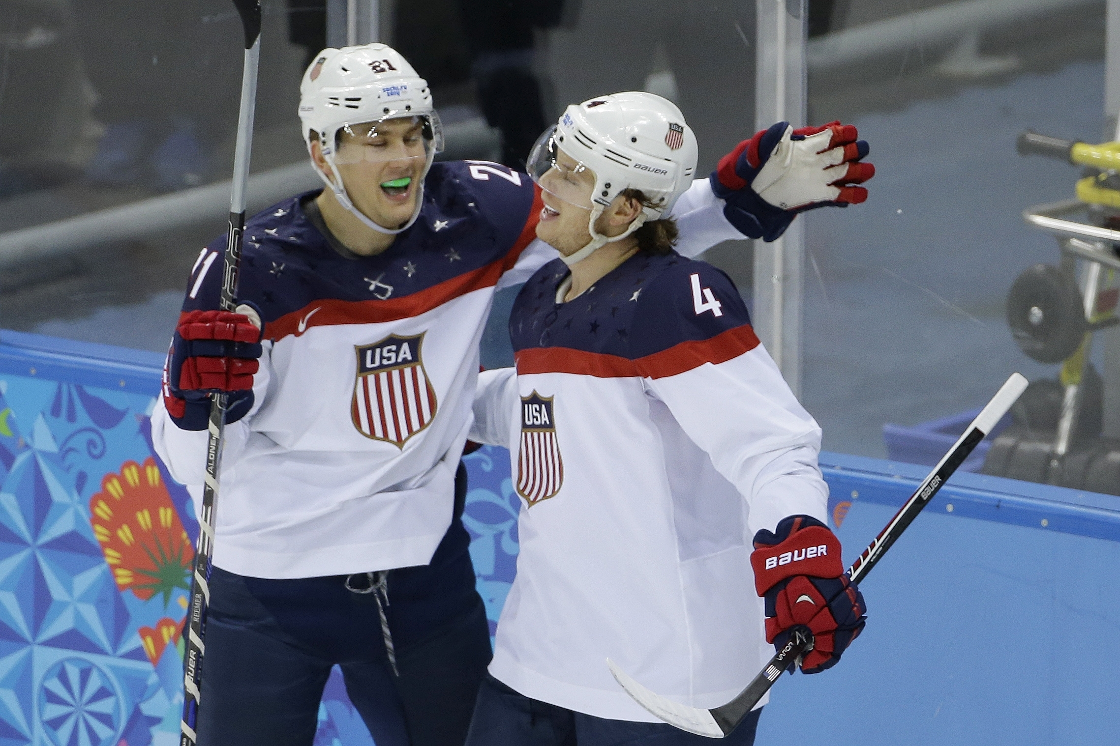 U.S. defenseman John Carlson, right, is congratulated for his goal against Slovakia by teammate James van Riemsdyk during Thursday's game in Shayba Arena.