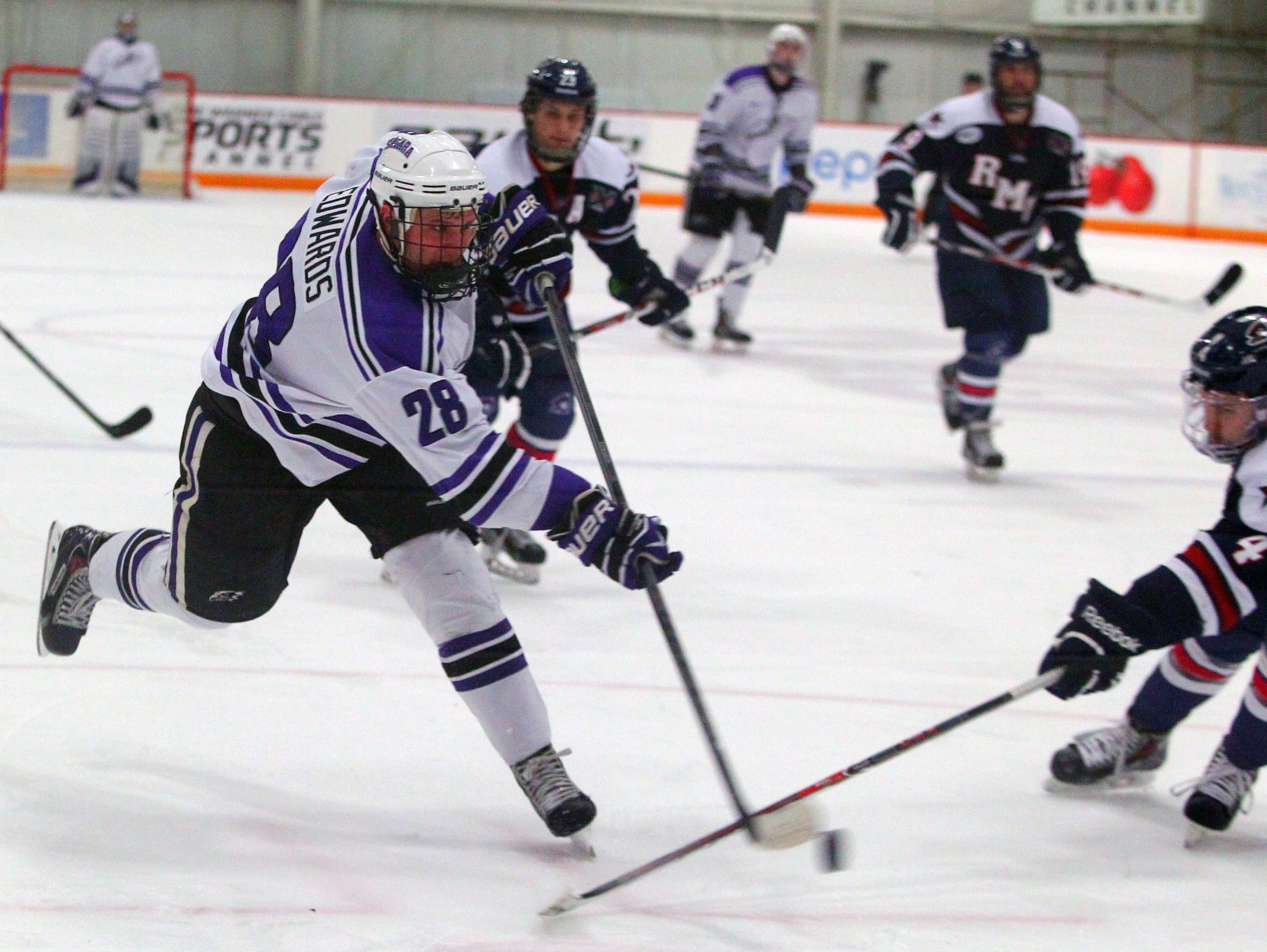Niagara's Brock Edwards lets a shot go in the second period against Robert Morris during their game at Dwyer Arena.