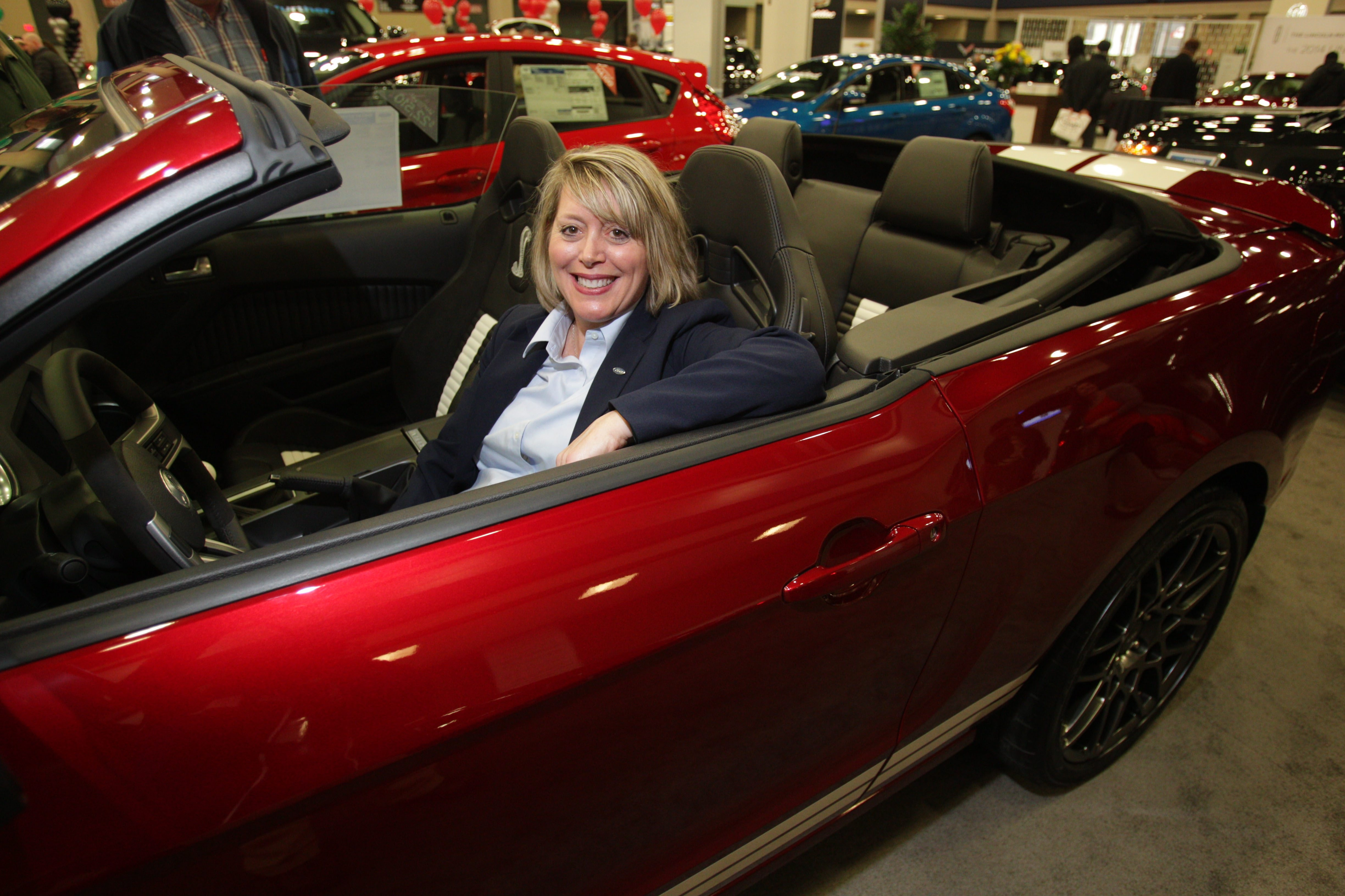 Liz Dwyer the regional manager for Ford, sitting in the Mustang Shelby Cobra at the 2014 Buffalo Auto Show, said there is plenty of business to support the region's Ford dealers.