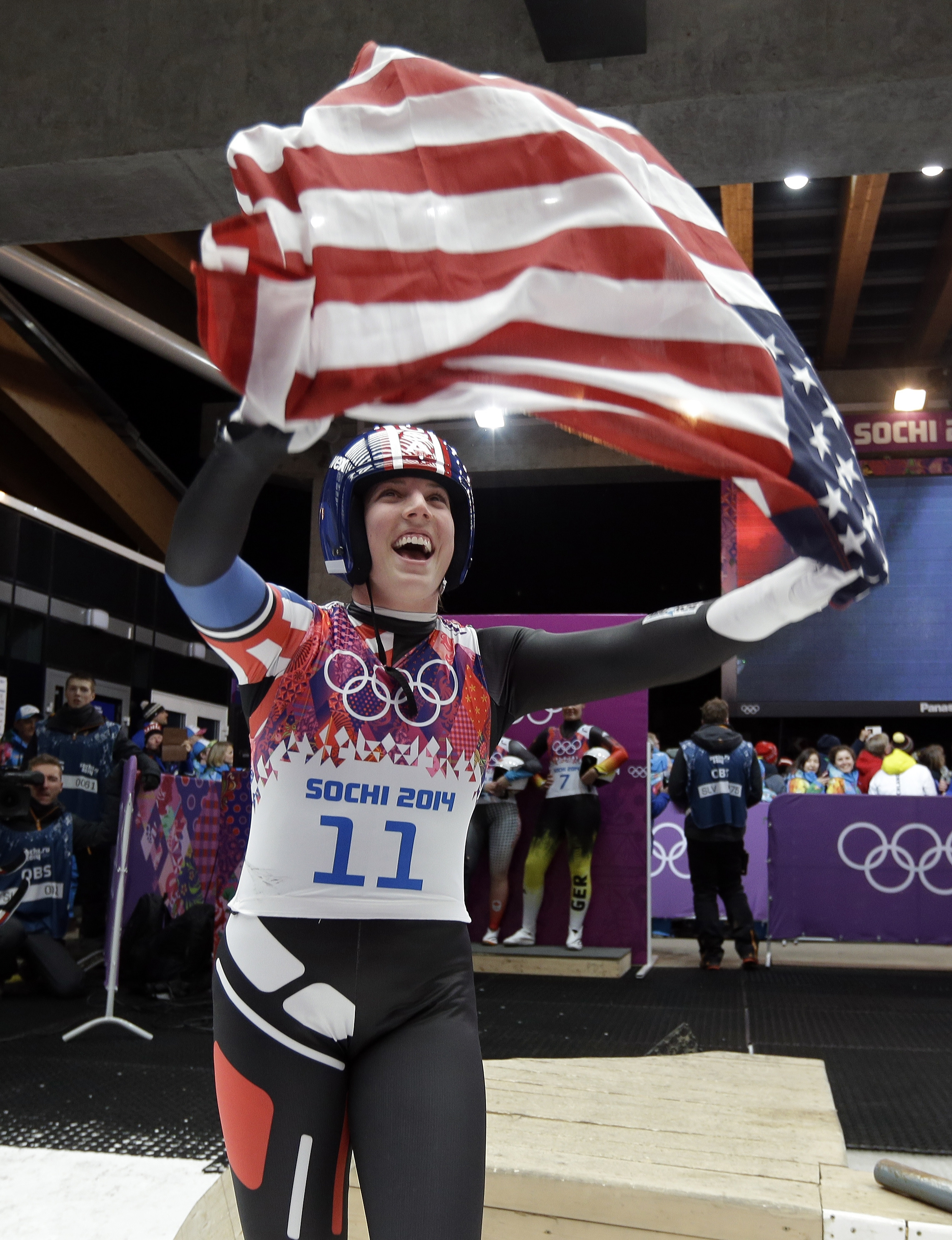Erin Hamlin, from Remsen, N.Y., celebrates Tuesday after winning the first singles medal for an American in Olympic luge competition.