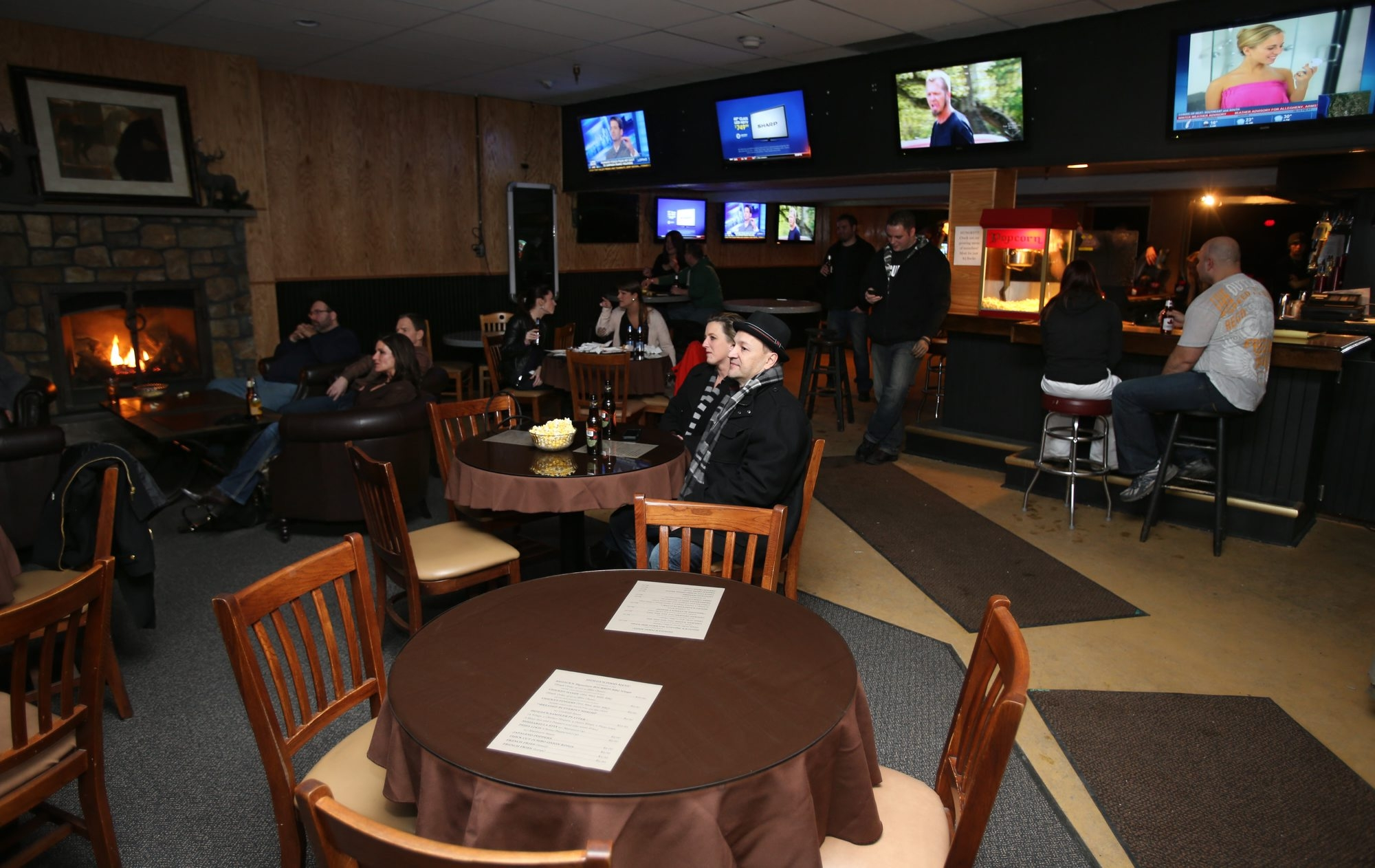 A cozy front room in Howdy's has nice seating around a fireplace and plenty of places to watch a game. At left, the Michael Bly Band performs on a large stage near the dance floor.
