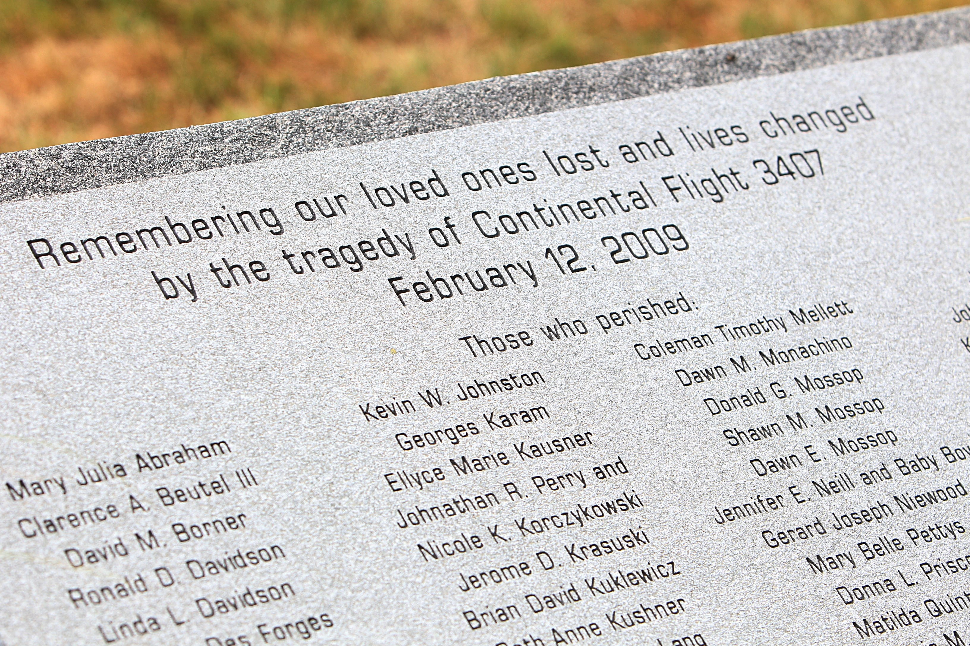 The Continental Flight 3407 memorial is as long as the wingspan of the plane, with stepping stones that represent each life lost in the crash.  {Photo by Sharon Cantillon / Buffalo News}