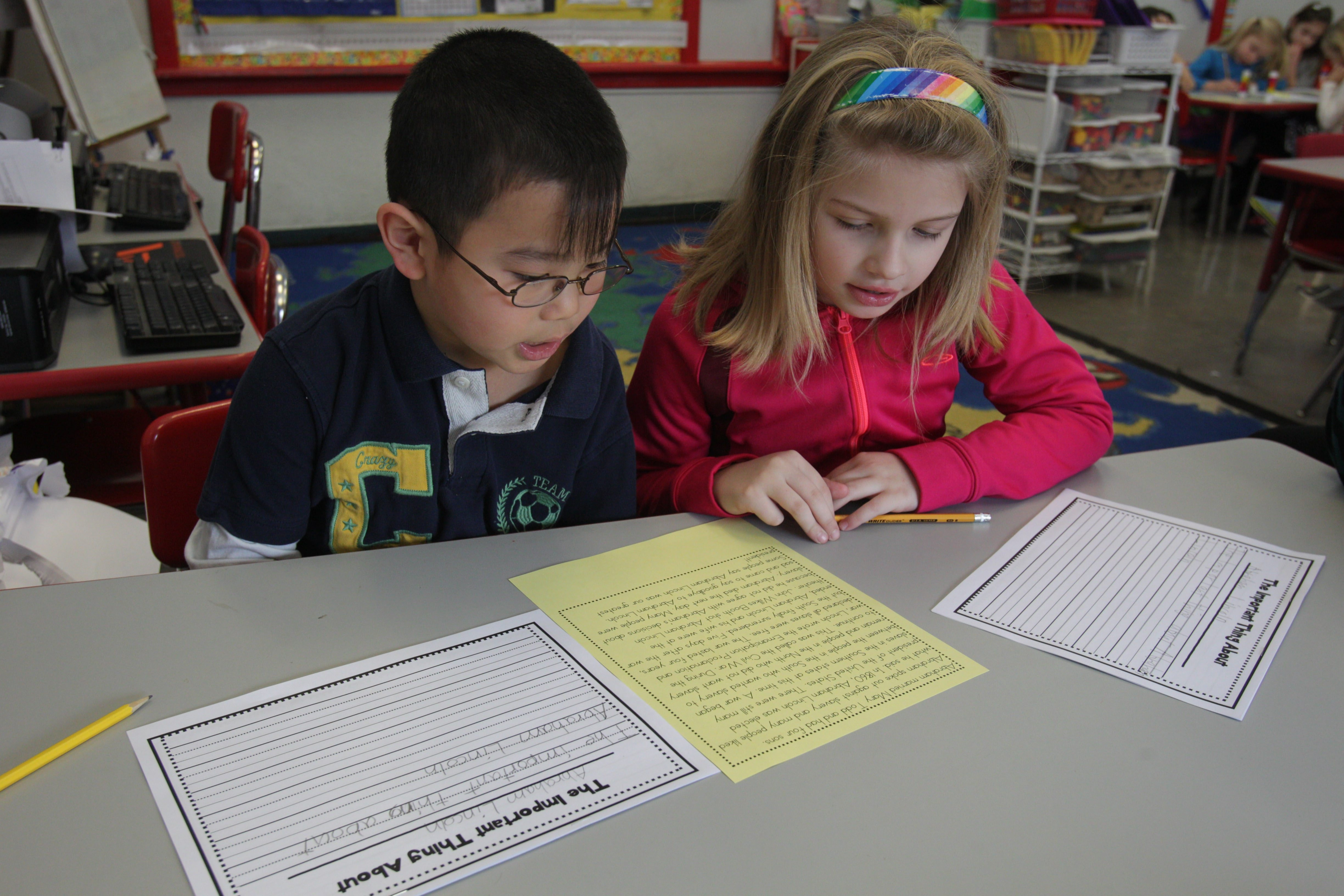 Rather than fight Common Core, teachers at Smallwood Elementary School have spent years developing new teaching strategies. Here, second-graders Caleb Chen and Meghan Roberts work on a writing project.