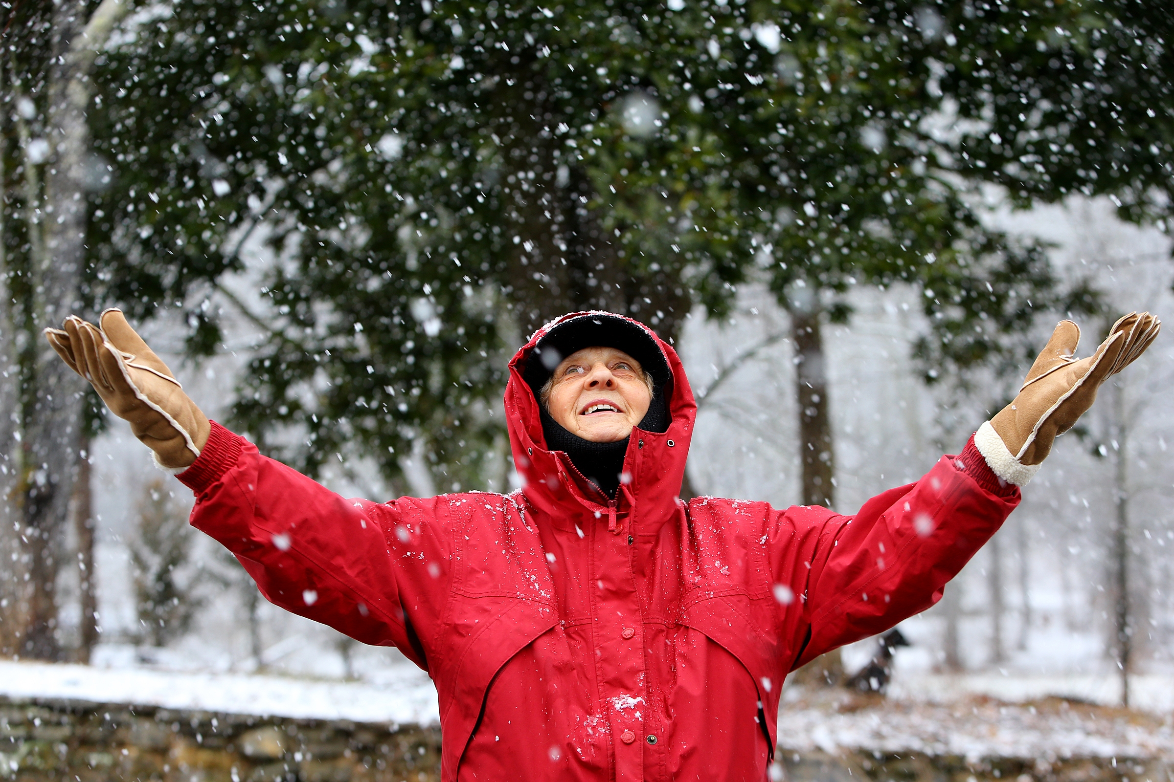 Loretta Cantrell, 75, holds out her hands as snow falls while she walks Tuesday in Helen, Ga. A storm of ice and snow is zeroing in on the South. Our area will be spared.