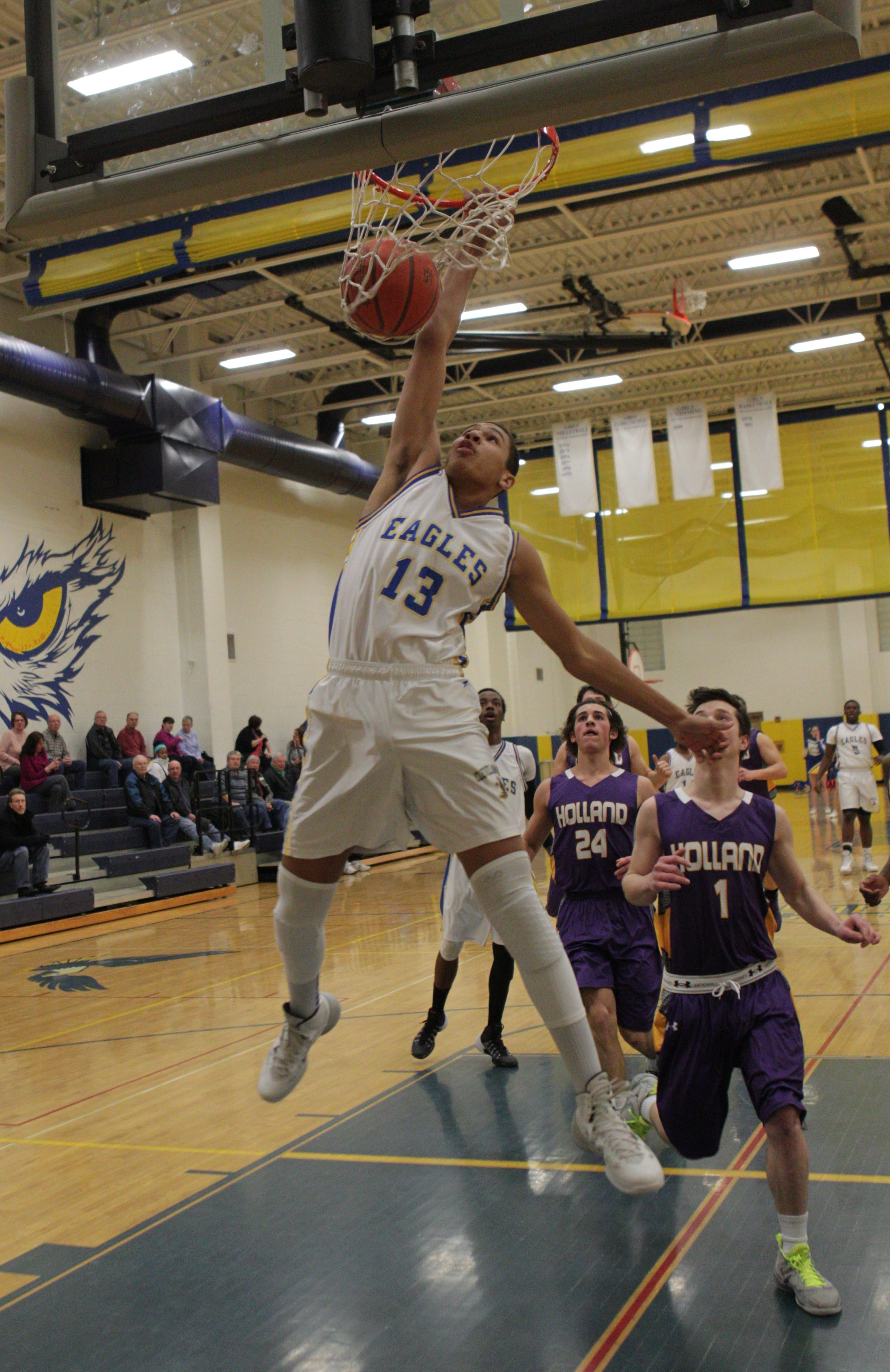 Aaron Phillips of Cleveland Hill goes for a slam dunk early in the Golden Eagles' ECIC IV victory over Holland.