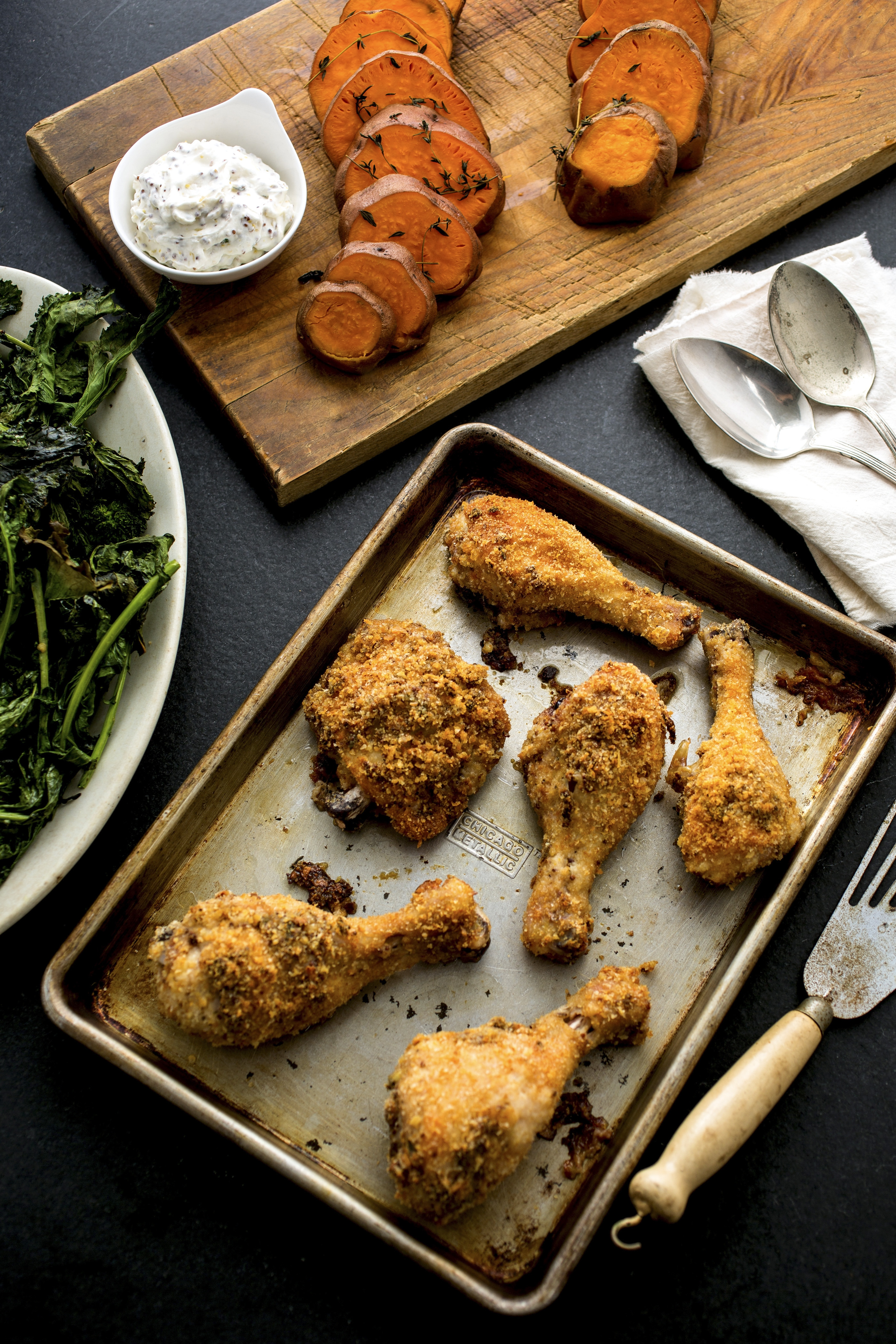 Chicken with mustard breadcrumbs, sweet potatoes with thyme and broccoli rabe, all cooked on a single sheet pan.