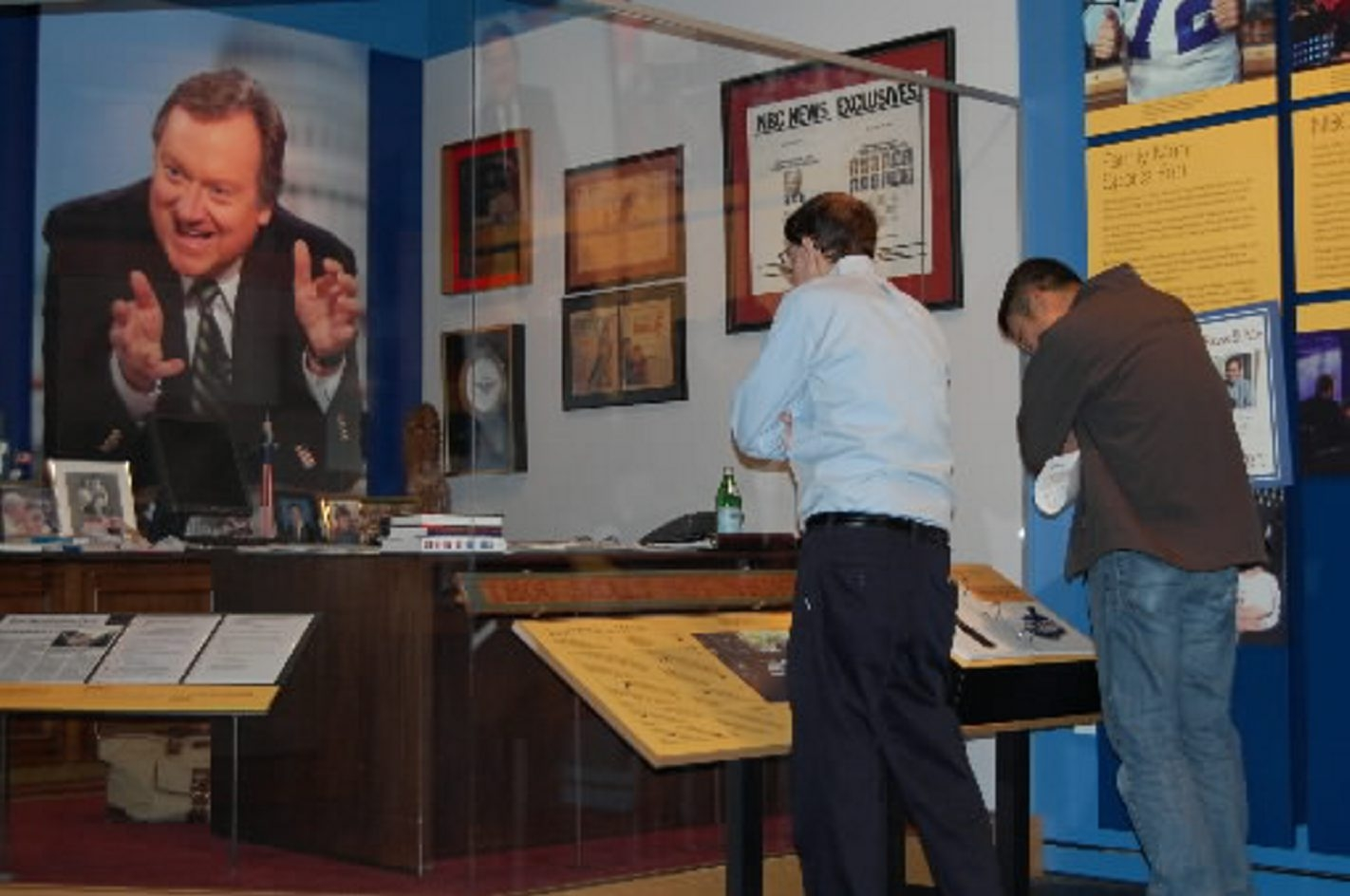 Tim Russert's image dominates re-creation of his office that will be a fixture in his hometown, beginning in September.