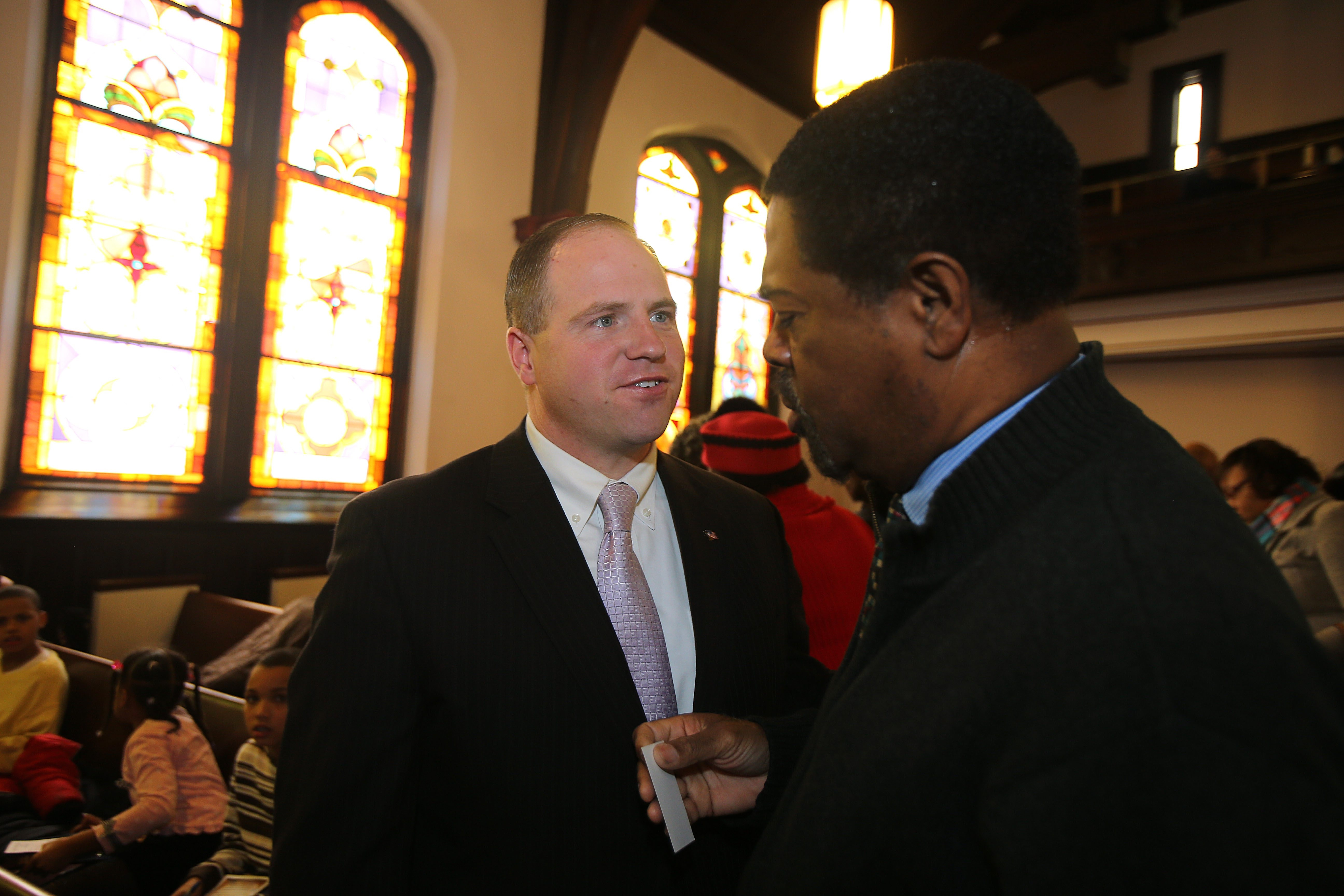 State Sen. Timothy Kennedy, speaking with Randy Edwards, foreground, as well as worshipping in a pew, appears at Bethel AME Church as African-American votes are key in re-election race with Betty Jean Grant; he outdid her in '12 primary by margin of 139.