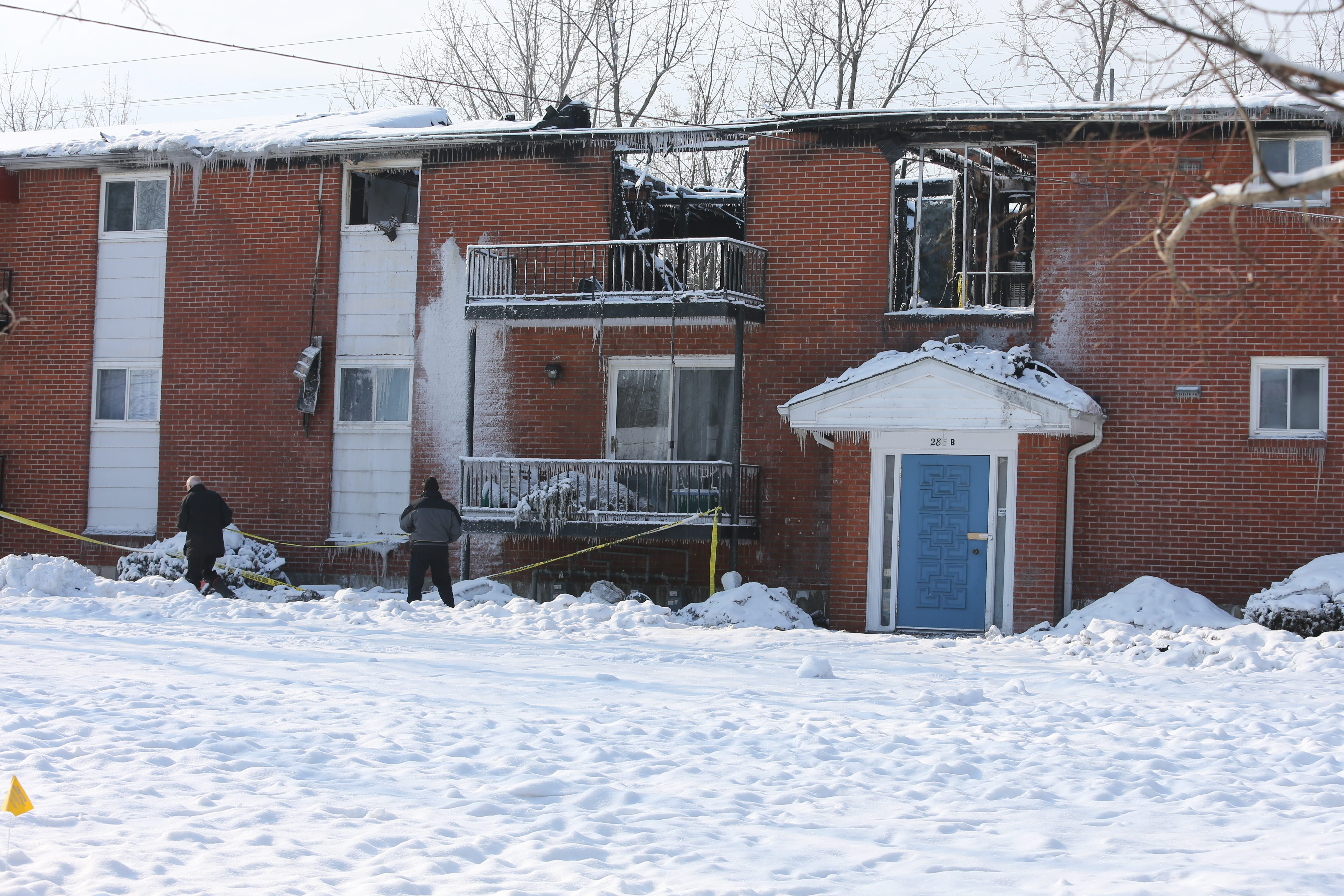 The outside of the apartment building on Scamridge Curve in Amherst, where a deadly fire took place, is seen Monday.