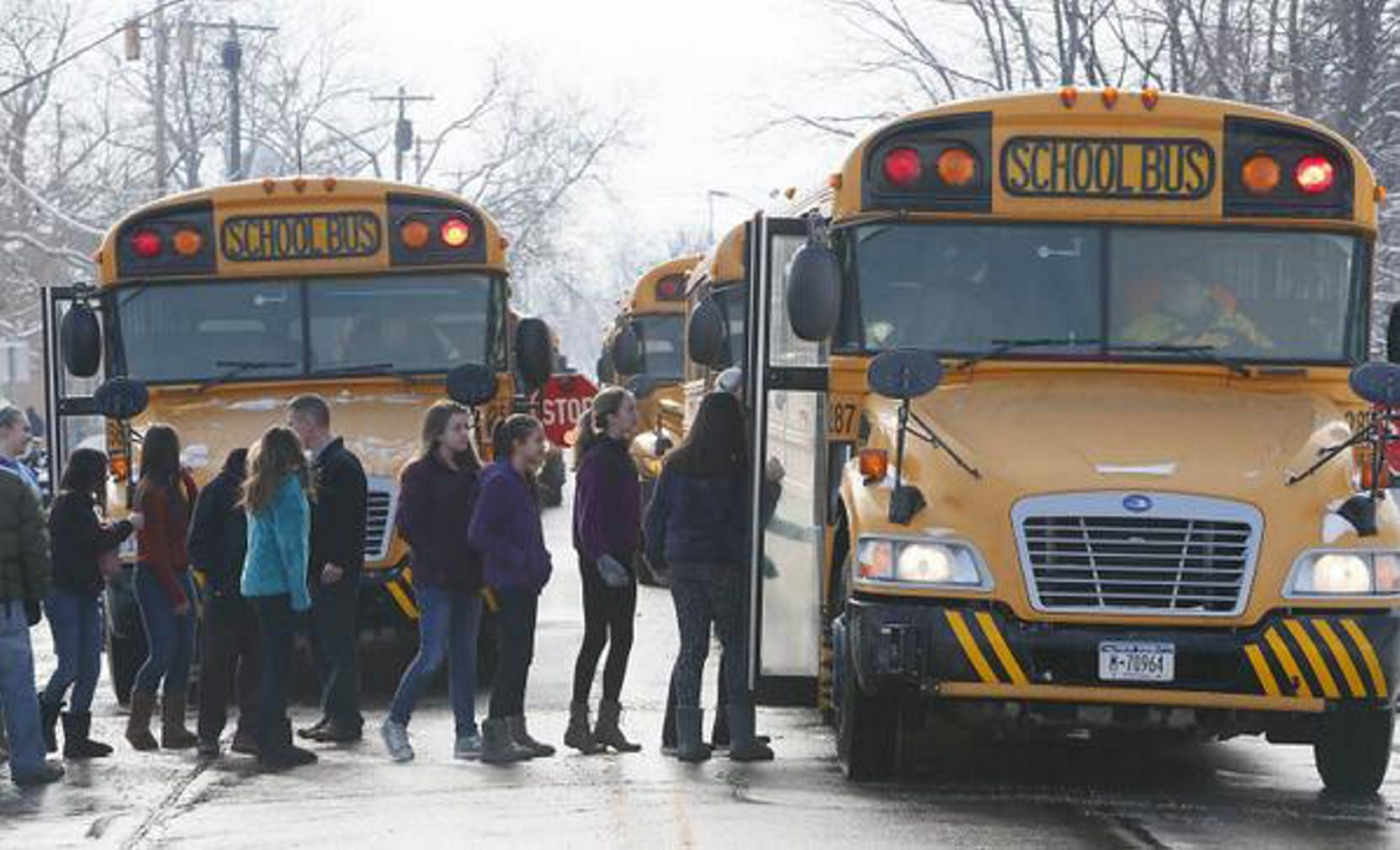 Niagara Wheatfield students board buses at the Sanborn Fire Hall to return to school after an evacuation Monday. (Derek Gee/Buffalo News)