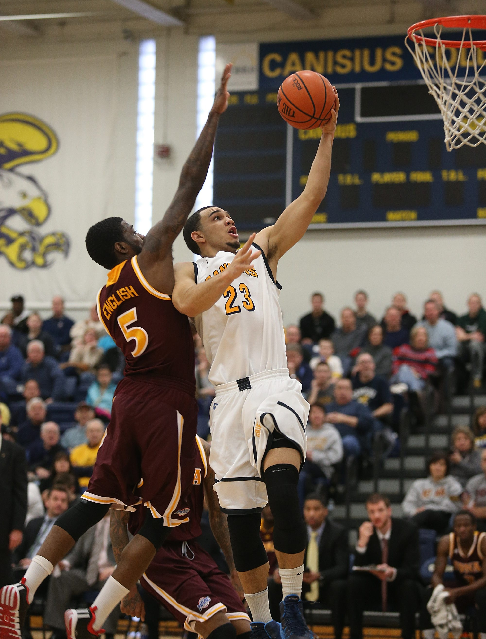 Canisius' Chris Perez, goes up for a shot as Iona's A.J. English defends during Sunday's game at the Koessler Athletic Center. Perez scored 24 points in a losing cause. English had a career-high 32 points.