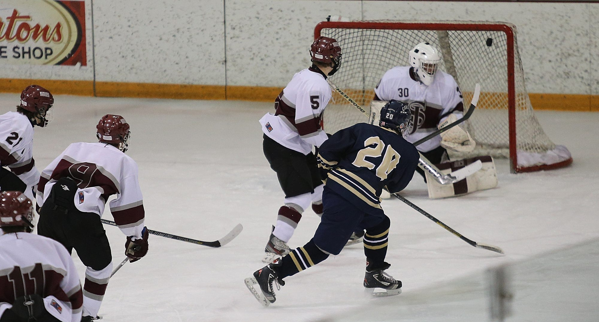Canisius' Joe Mancuso goes top shelf to score one of his two goals in a 6-3 victory over St. Joe's at Buffalo State.