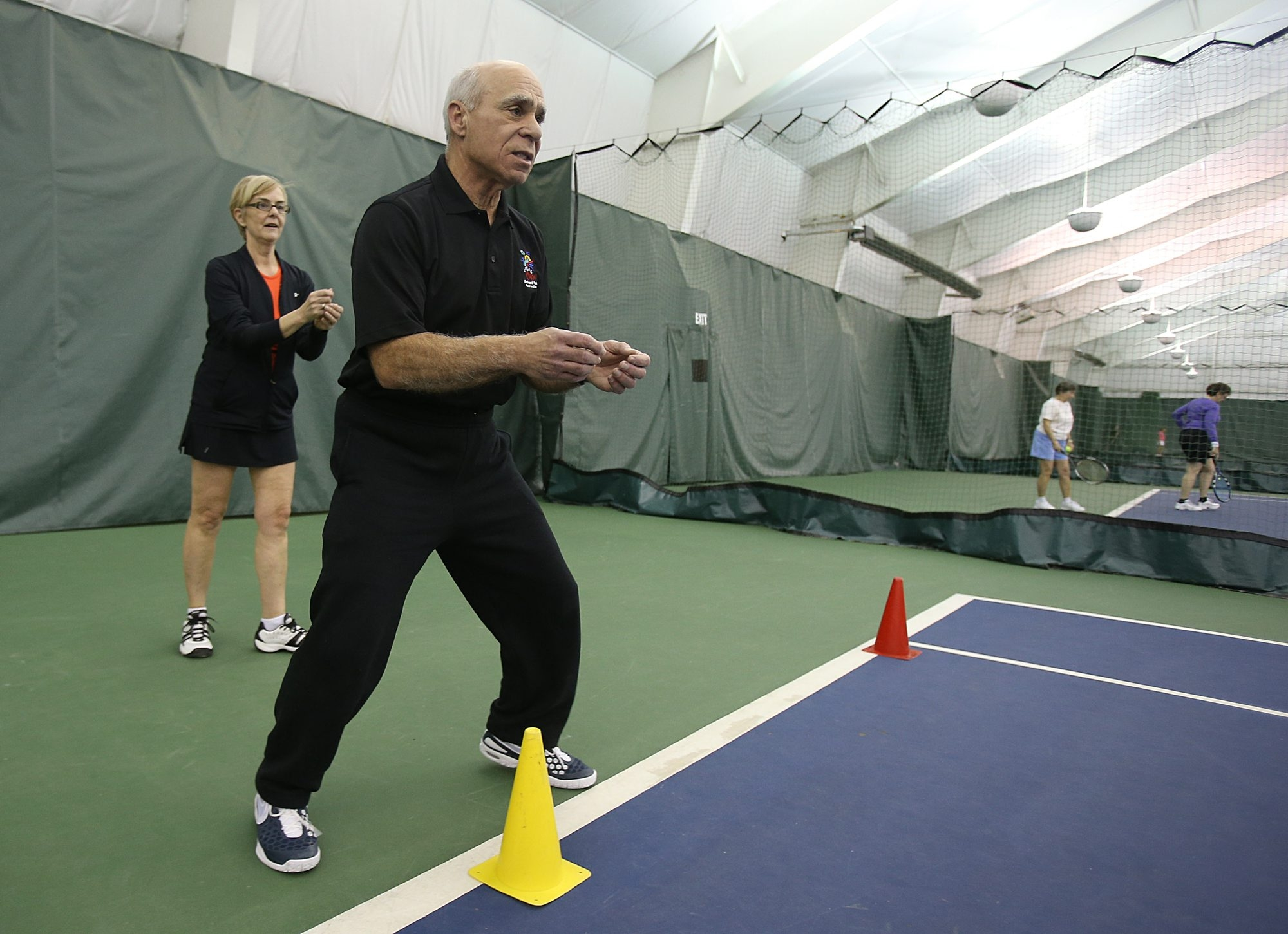 Tennis instructor Sam LaDuca works with client Sheila Pace, of Buffalo, at the Village Glen Tennis Club in Williamsville.