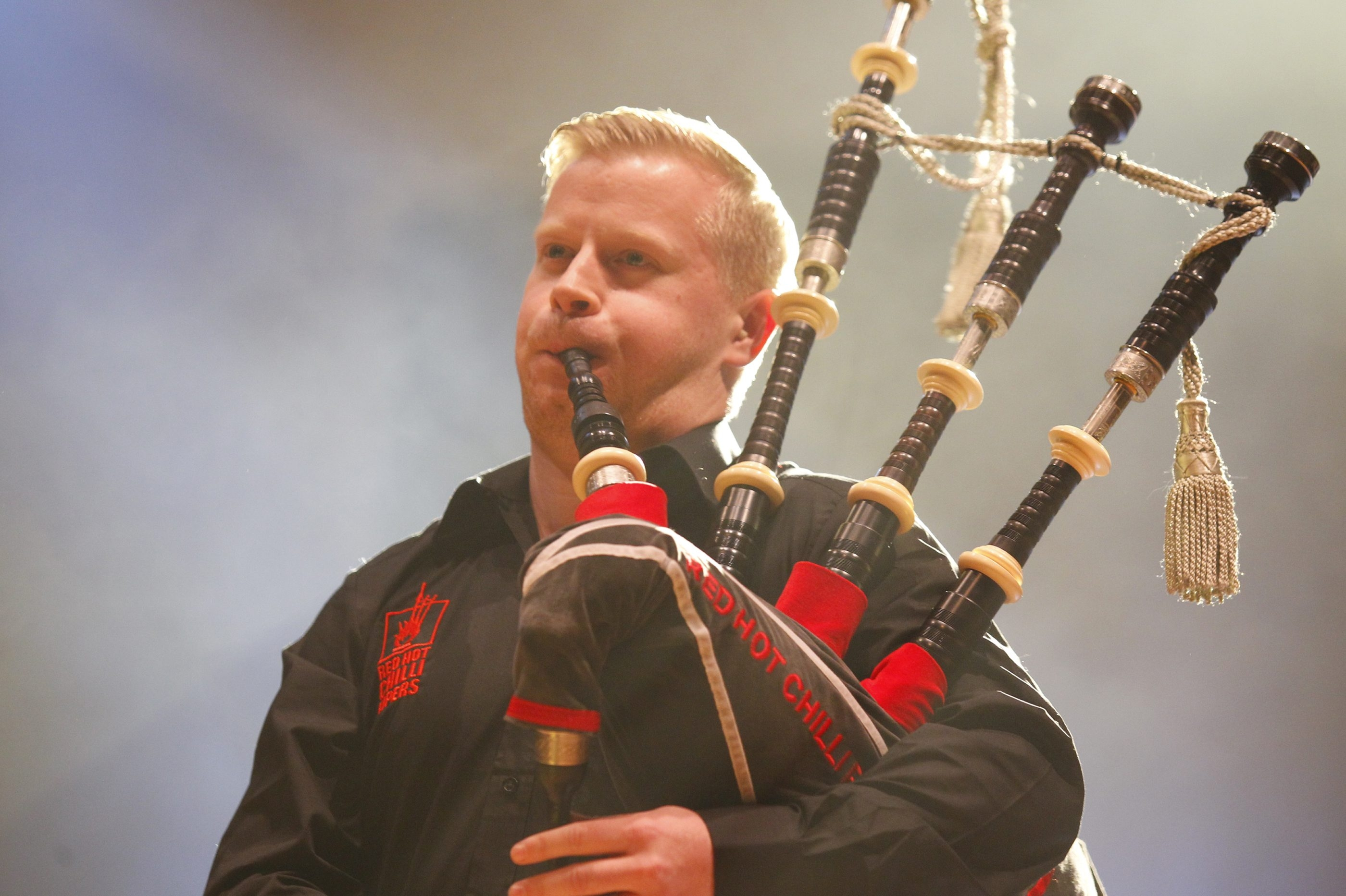 One of the Red Hot Chilli Pipers' bagpipers performs in Kleinhans Music Hall on Saturday.