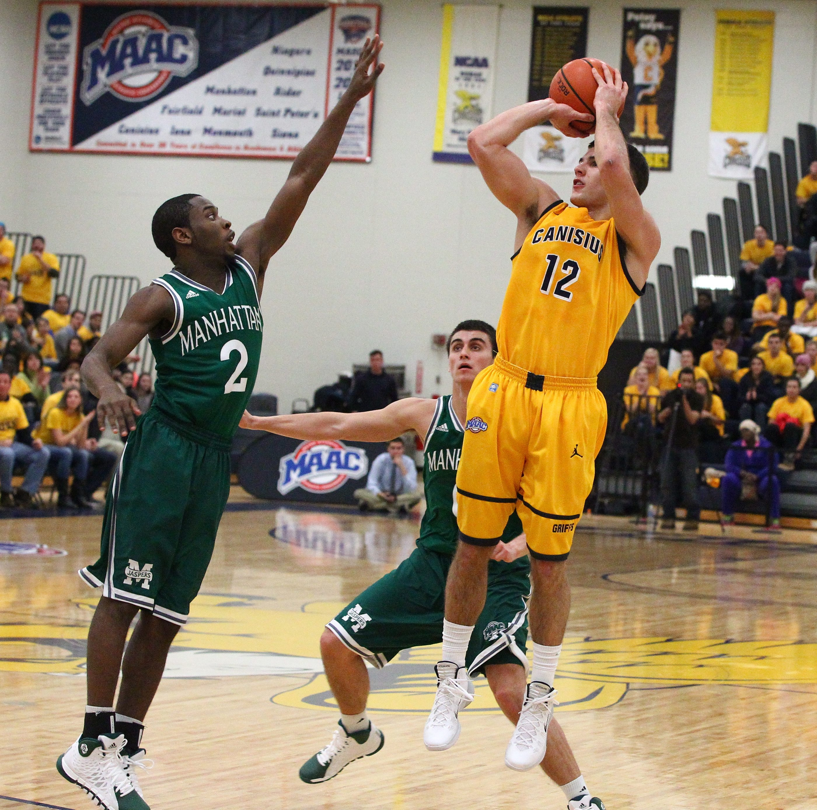 Canisius guard Billy Baron fires a three-pointer over Manhattan guard Tyler Wilson. The Jaspers defeated the Golden Griffins,  84-73, in the Koessler Athletic Center on Friday night.