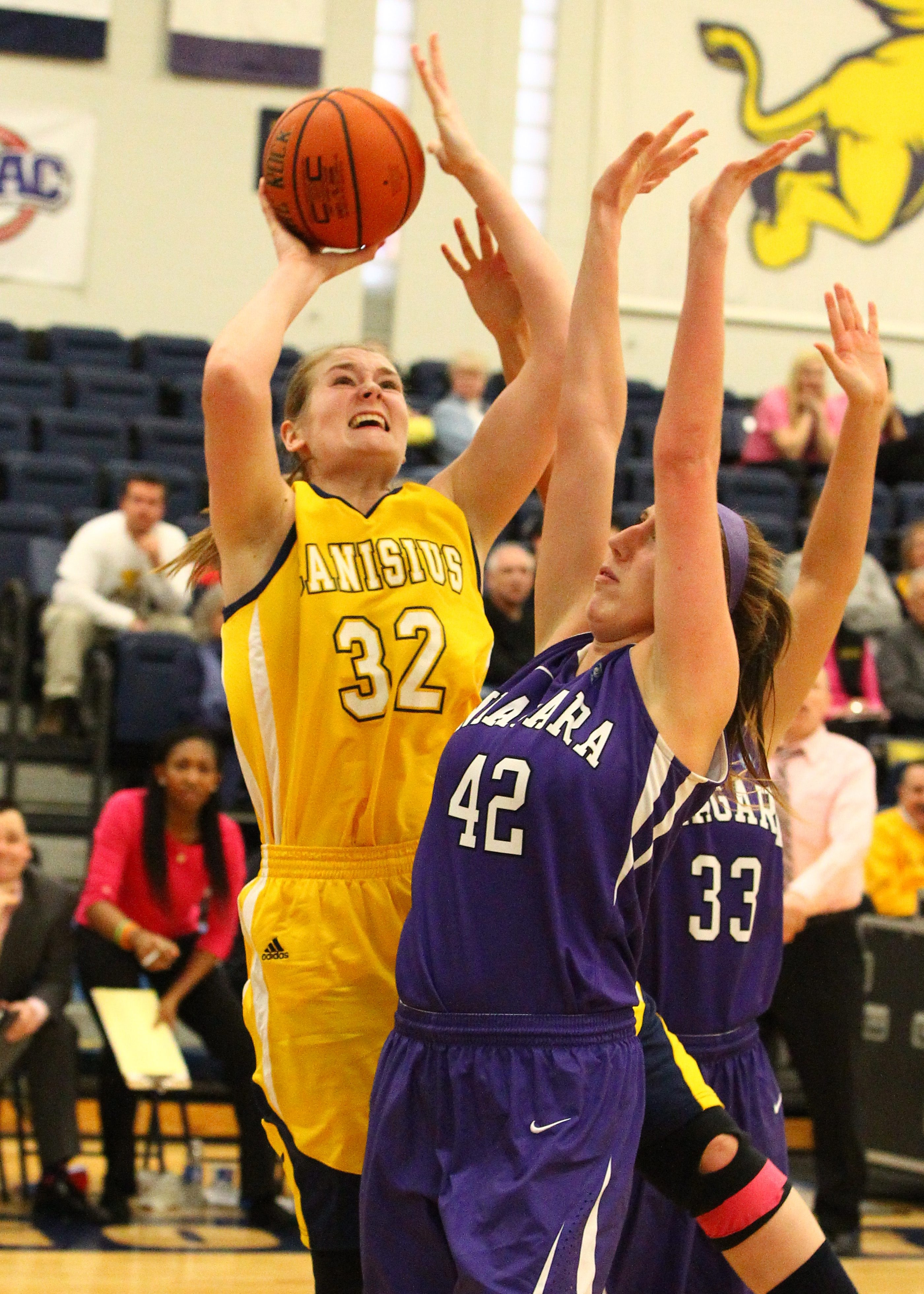 Canisius forward Jen Lennox has position on Niagara center Sam Lapszynski during the second half at the Koessler Athletic Center.