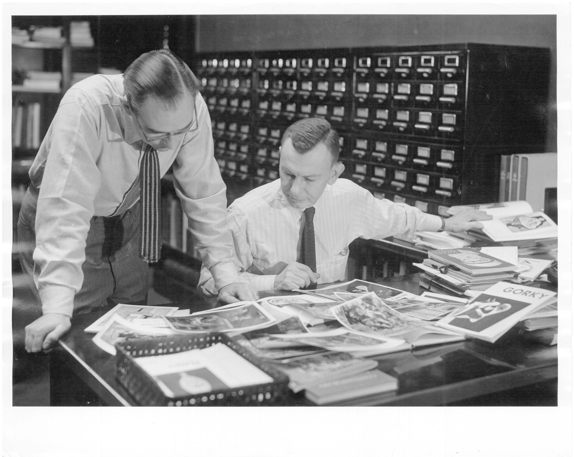 """Archive 1952 photo from the Albright Knox Art Gallery shows curator Patrick J. Kelleher with gallery director Edgar C. Schenck. Kelleher was among the 345 """"Monuments Men"""" whose mission was to find and return art treasures looted in Europe by the Nazis during World War II."""