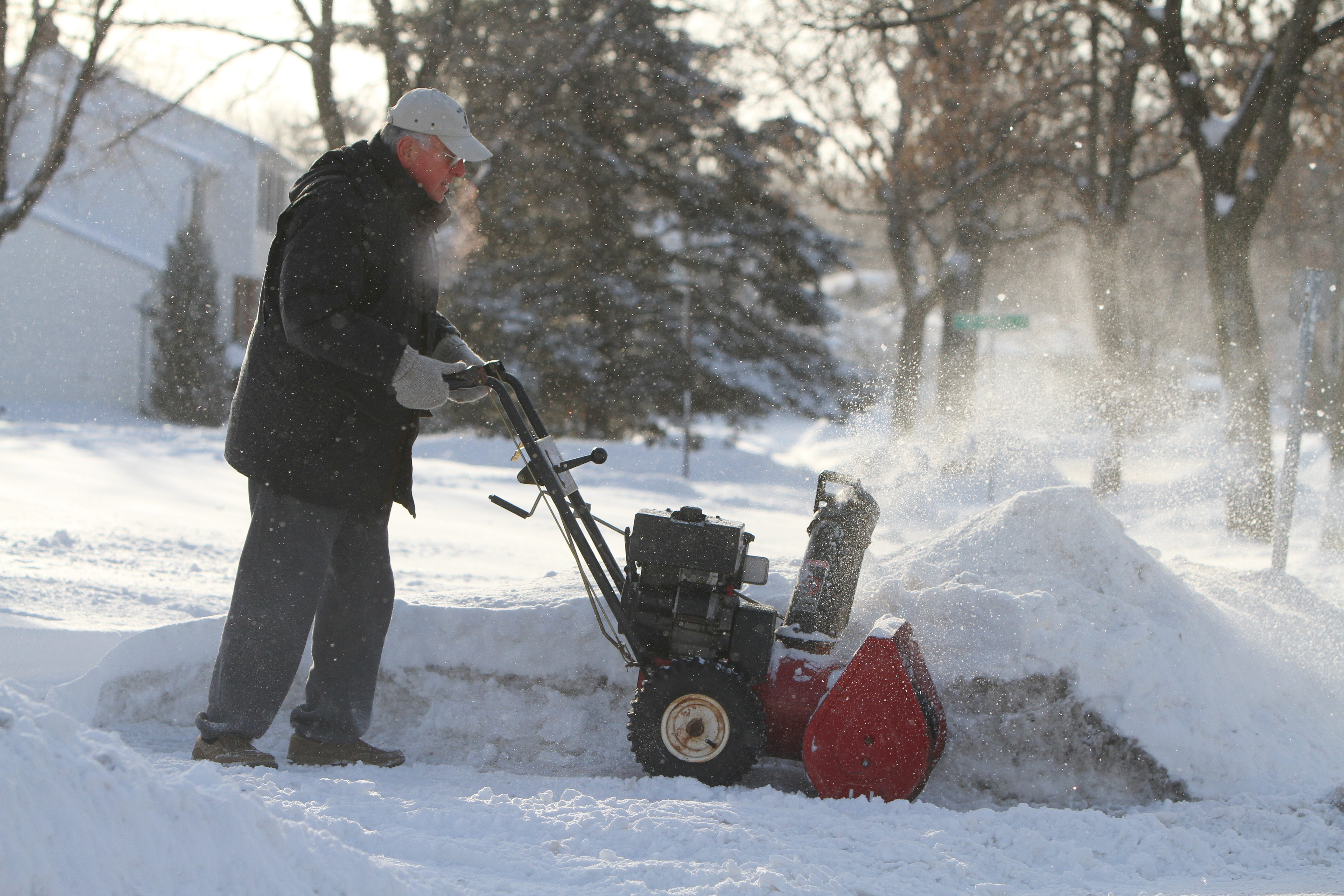 Bill Denhall clears his driveway in Williamsville today. Williamsville got 9.2 inches of snow over 48 hours.