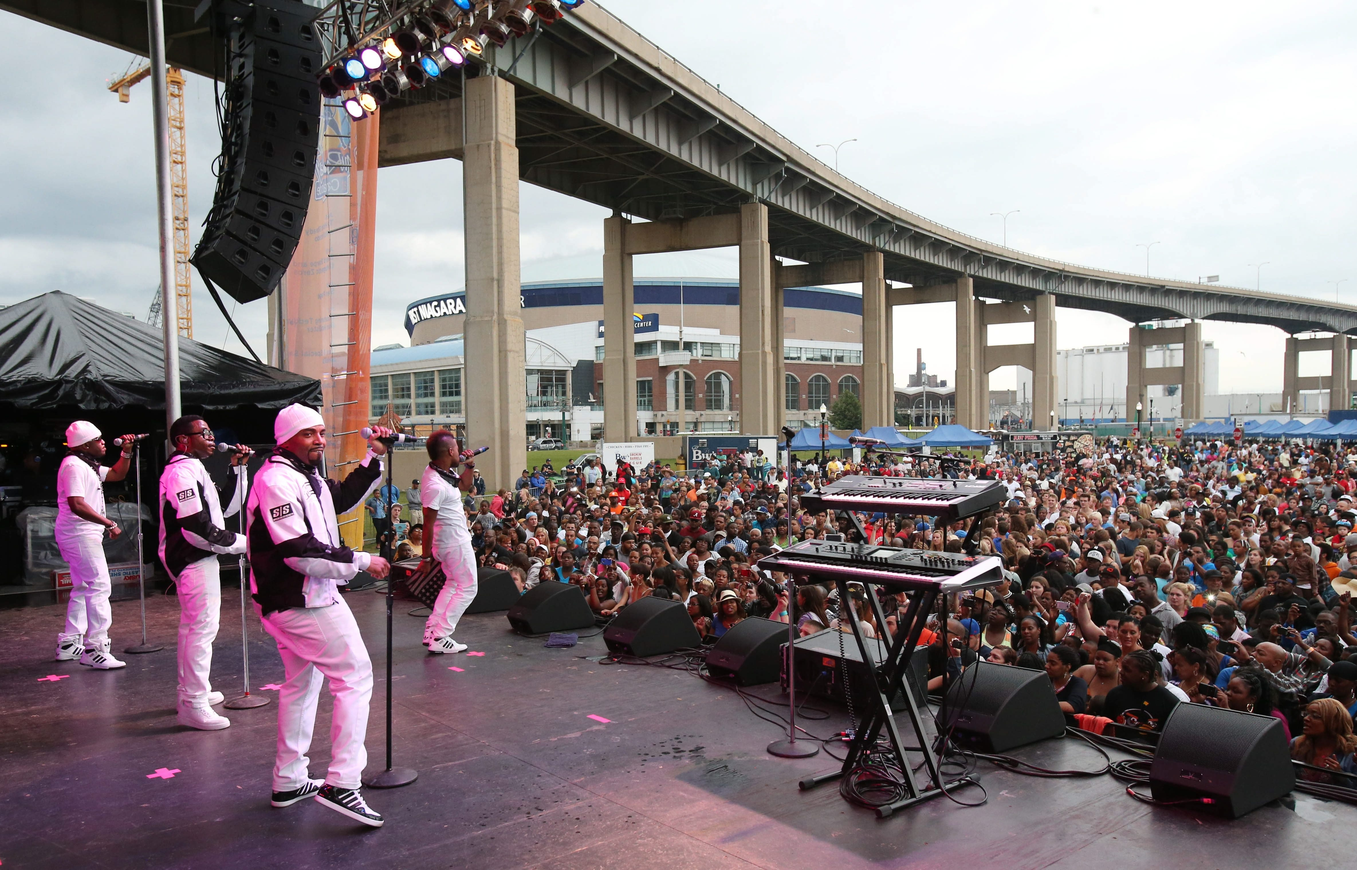 Teddy Riley, wearing white cap in the foreground, at his band's concert last June 27 in the Thursday at Canalside series, which is now in the hands of Global Spectrum.
