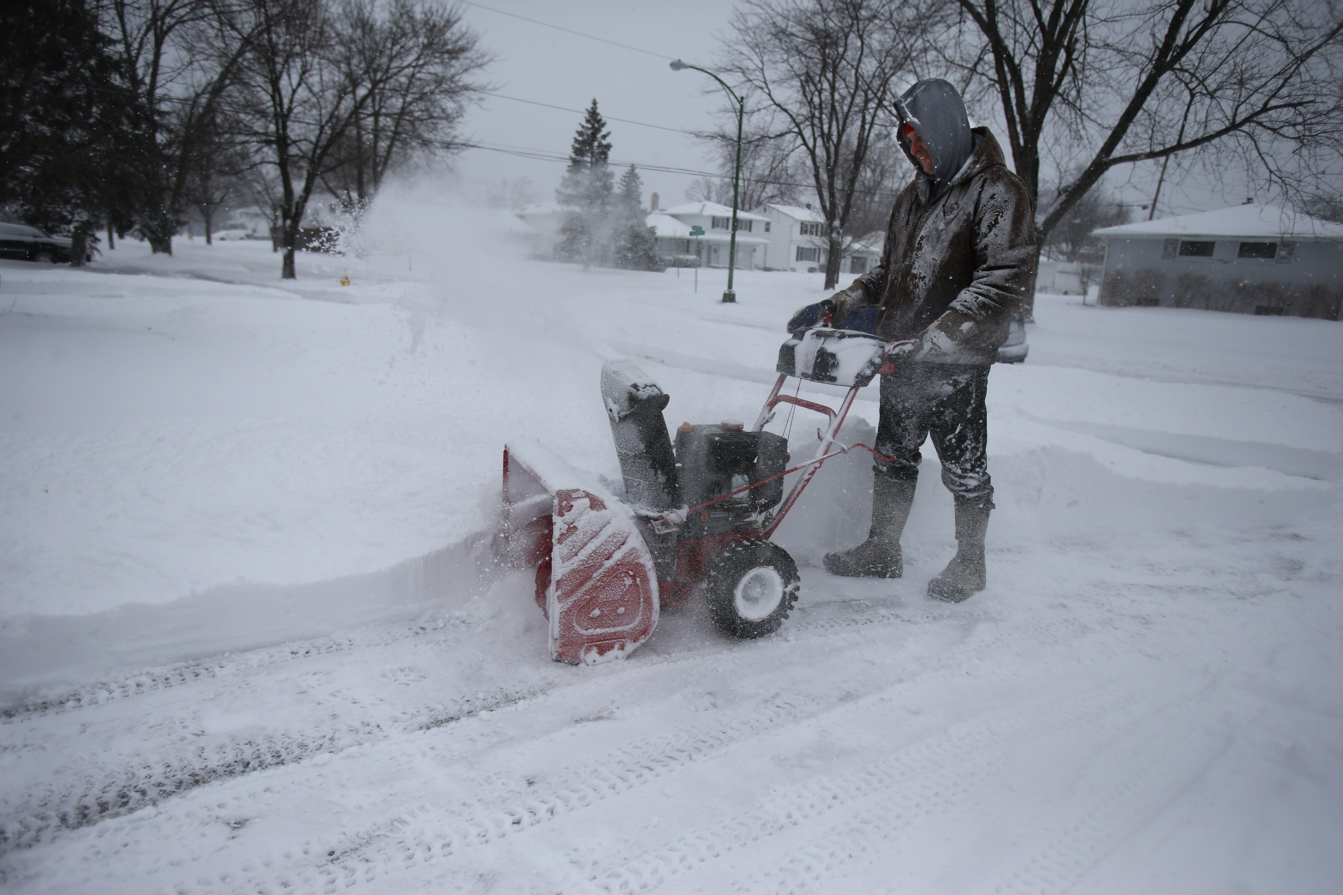 Bob Kendig uses a snowblower to clear his driveway in Amherst, Wednesday, February 5, 2014. (Charles Lewis/Buffalo News)