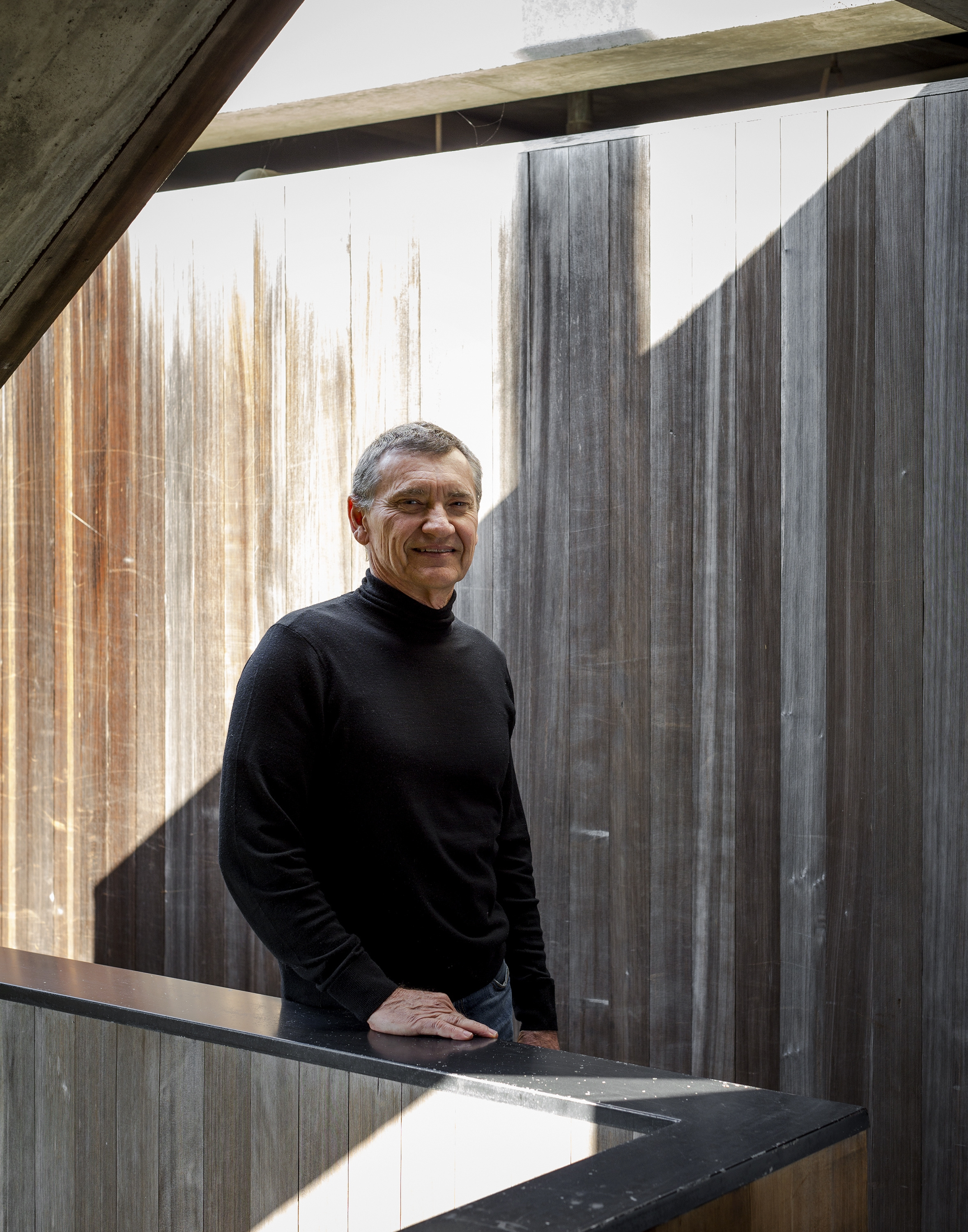 Robert Bridges at his home in Los Angeles, May 28, 2013. Built on concrete columns and cantilevered over the hillside, Bridges' brutalist home has become a Sunset Boulevard landmark. (Trevor Tondro/The New York Times)