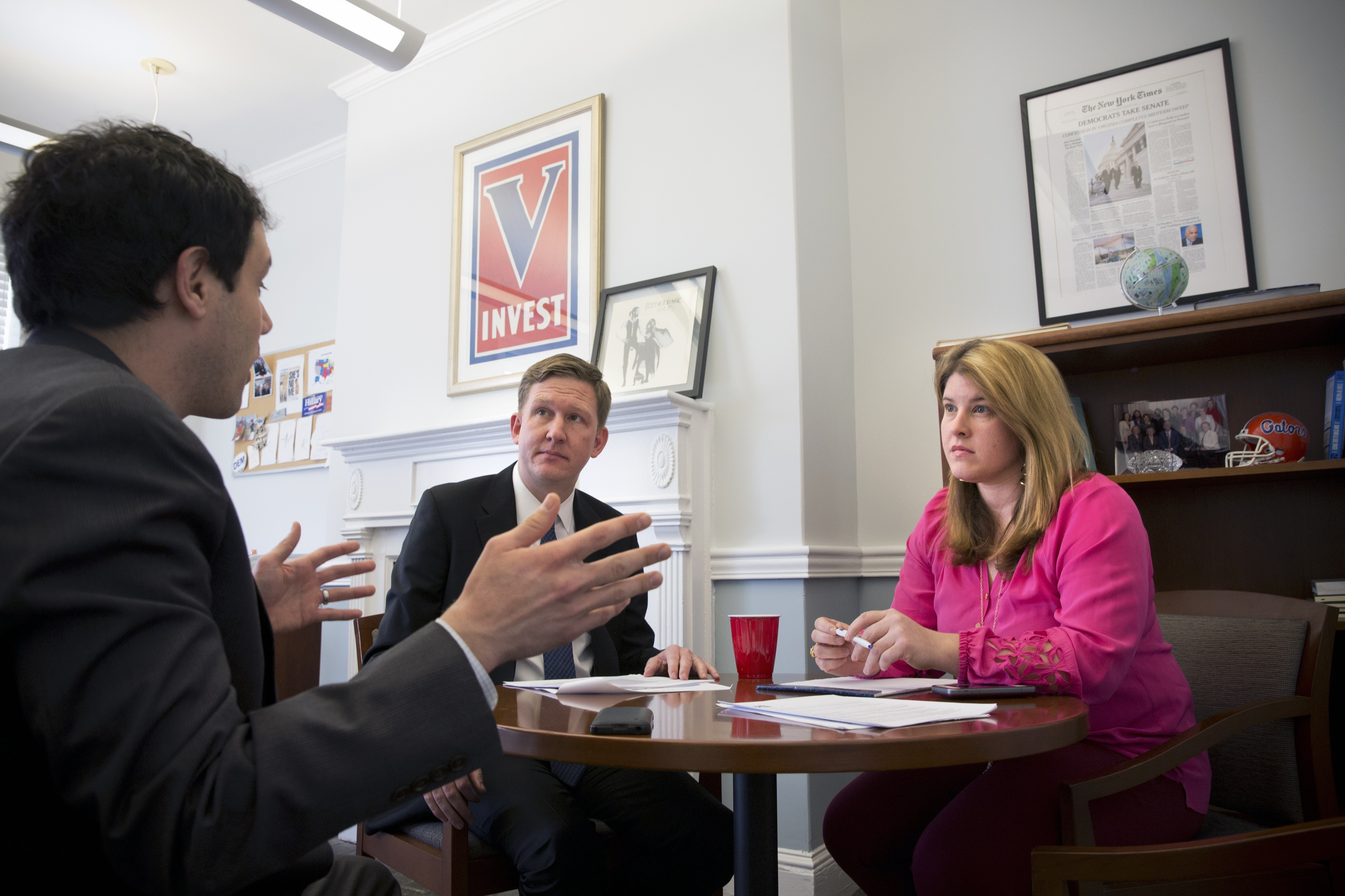 Guy Cecil, center, director of the Democratic Senatorial Campaign Committee, meets with political director Anne Caprara and deputy executive director Matt Canter.