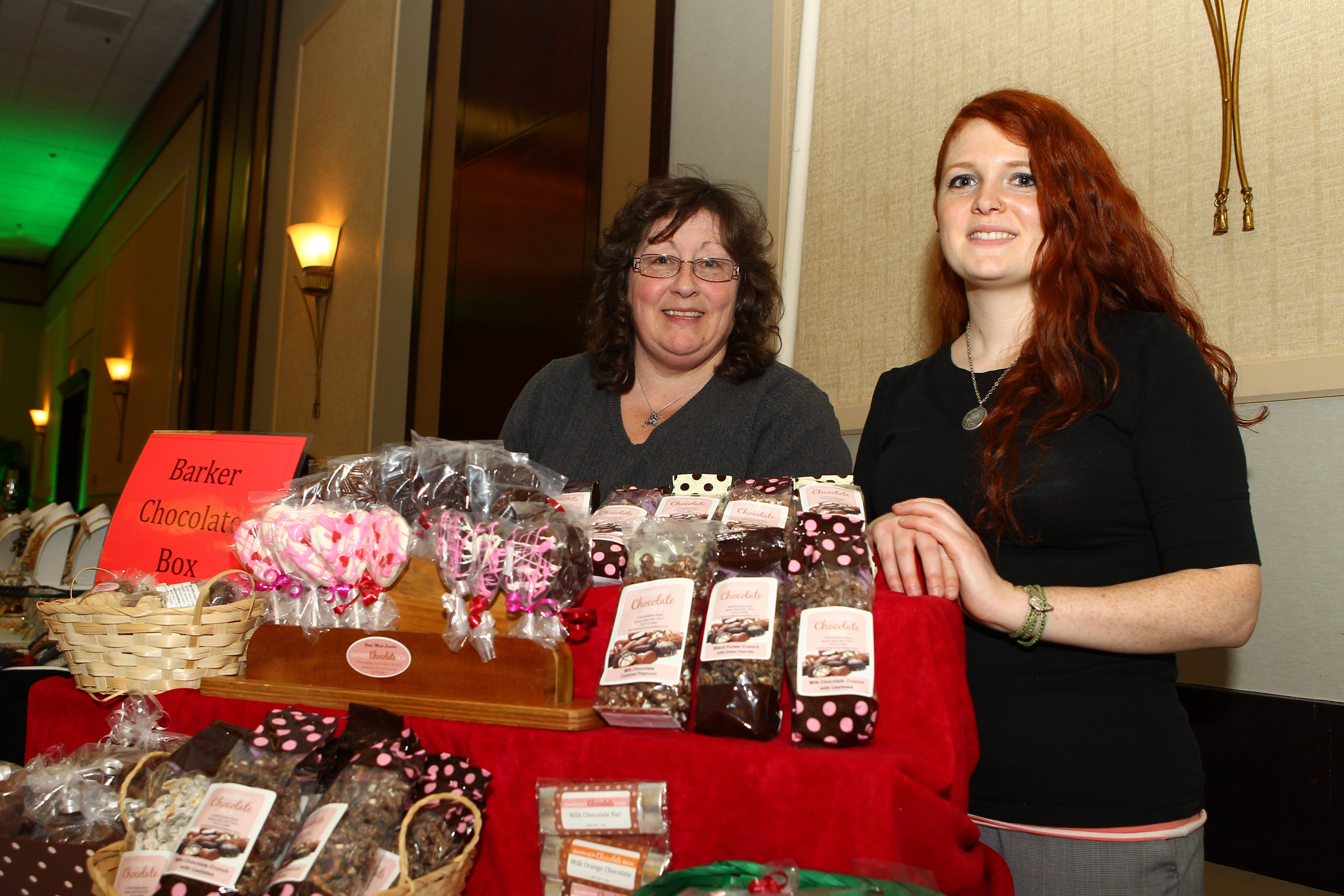 "Cindy Jex, left, owner of the Barker Chocolate Box, with her assistant, Gretchen Schweigert, display their goods at the ""Chocolate Affair"" on Jan. 30 in the Hyatt Regency Buffalo. Valentine's Day is sure to keep them hopping."