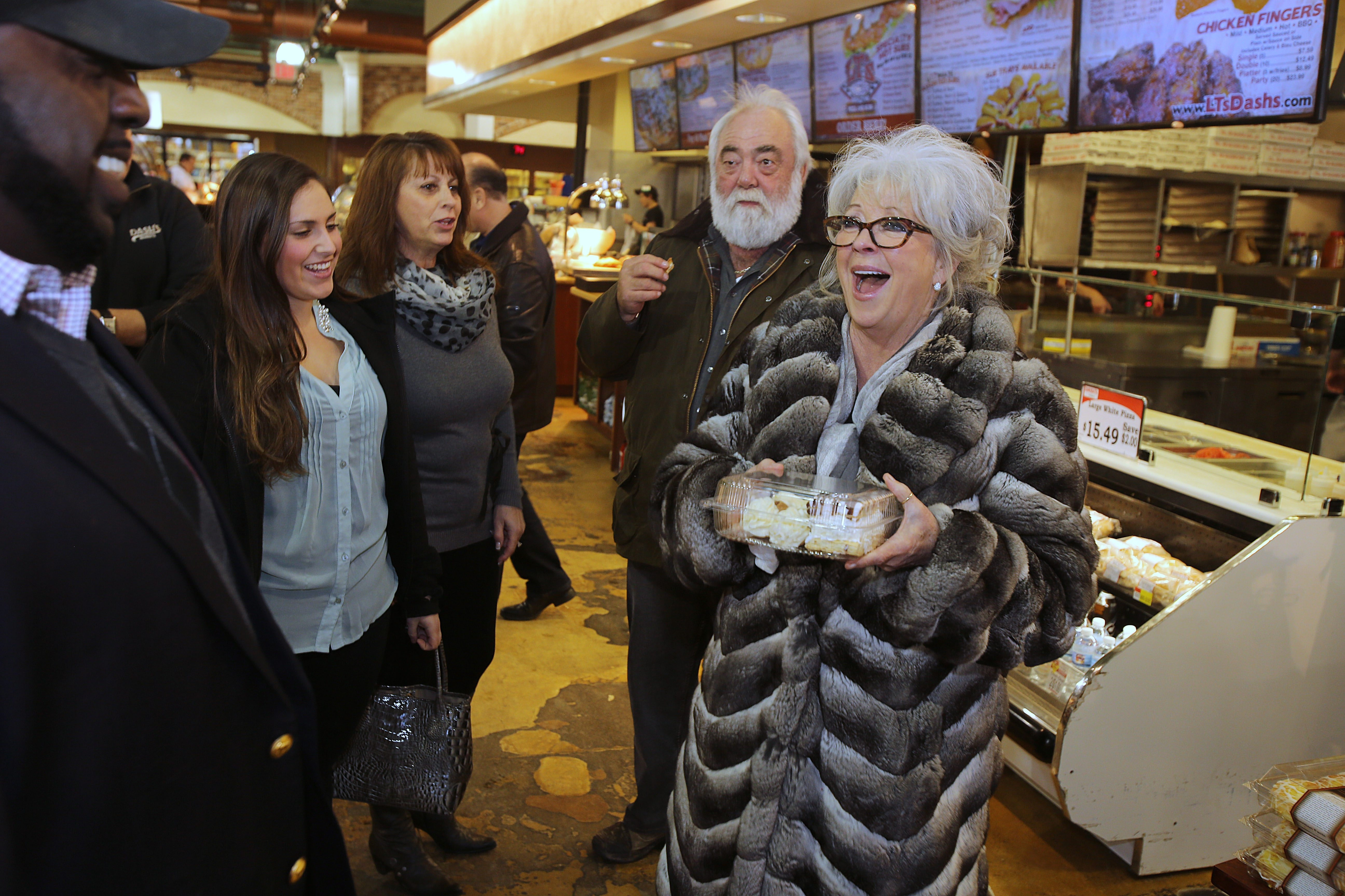 Celebrity Chef Paula Deen, right, accompanied by her husband, Michael Groover, talks Friday with Eileen Dash, center, and Alexa Dash at Dash's Market in Clarence.