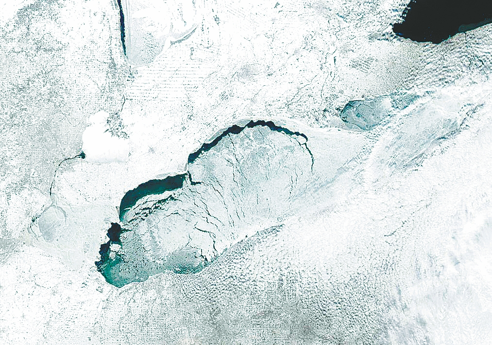 This NASA satellite image of Lake Erie taken Monday shows fractured ice off the Canadian shore, west of Long Point, Ont. As of Monday, ice covered about 89 percent of Lake Erie; coverage was 95 percent in January. Wind patterns can break up the ice, scientists say, and the ice cover plays a significant role in reducing the amount of lake-effect snowfall in Western New York.