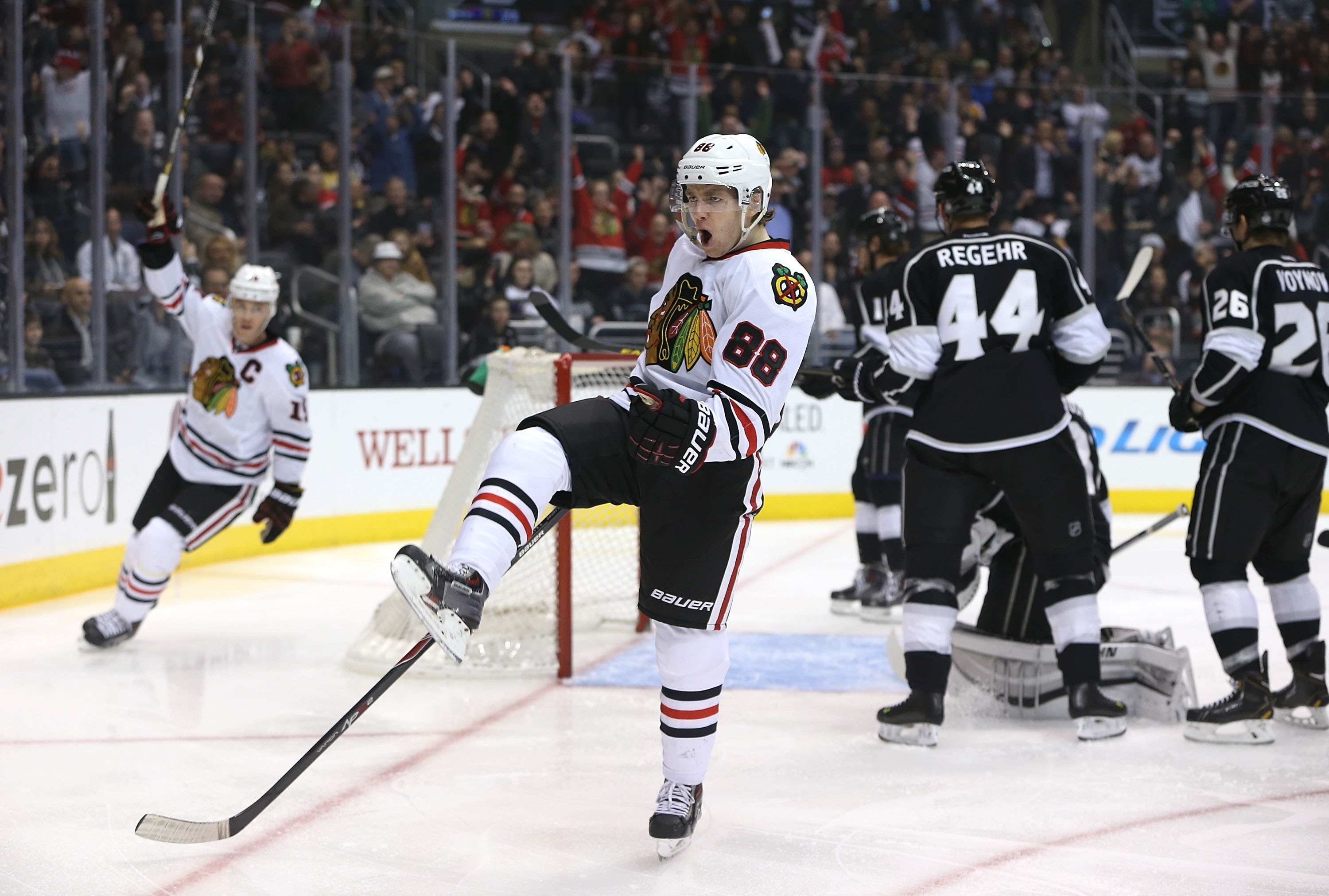 Patrick Kane celebrates his first-period goal against the Kings on Monday. Kane found out before the game that his grandfather died.