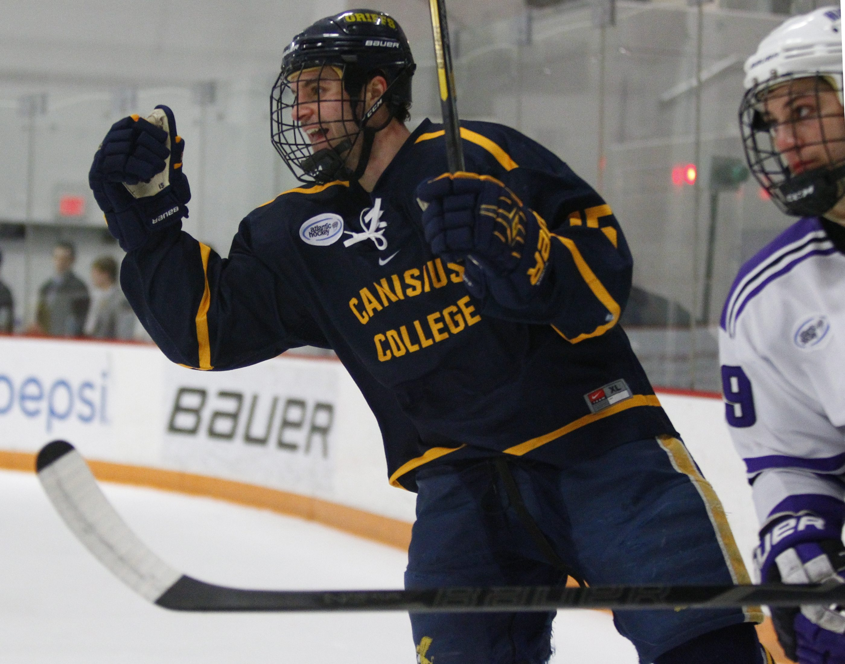 Kyle Gibbons (15) of Canisius celebrates a first-period goal against Niagara during their game at Dwyer Arena Thursday.