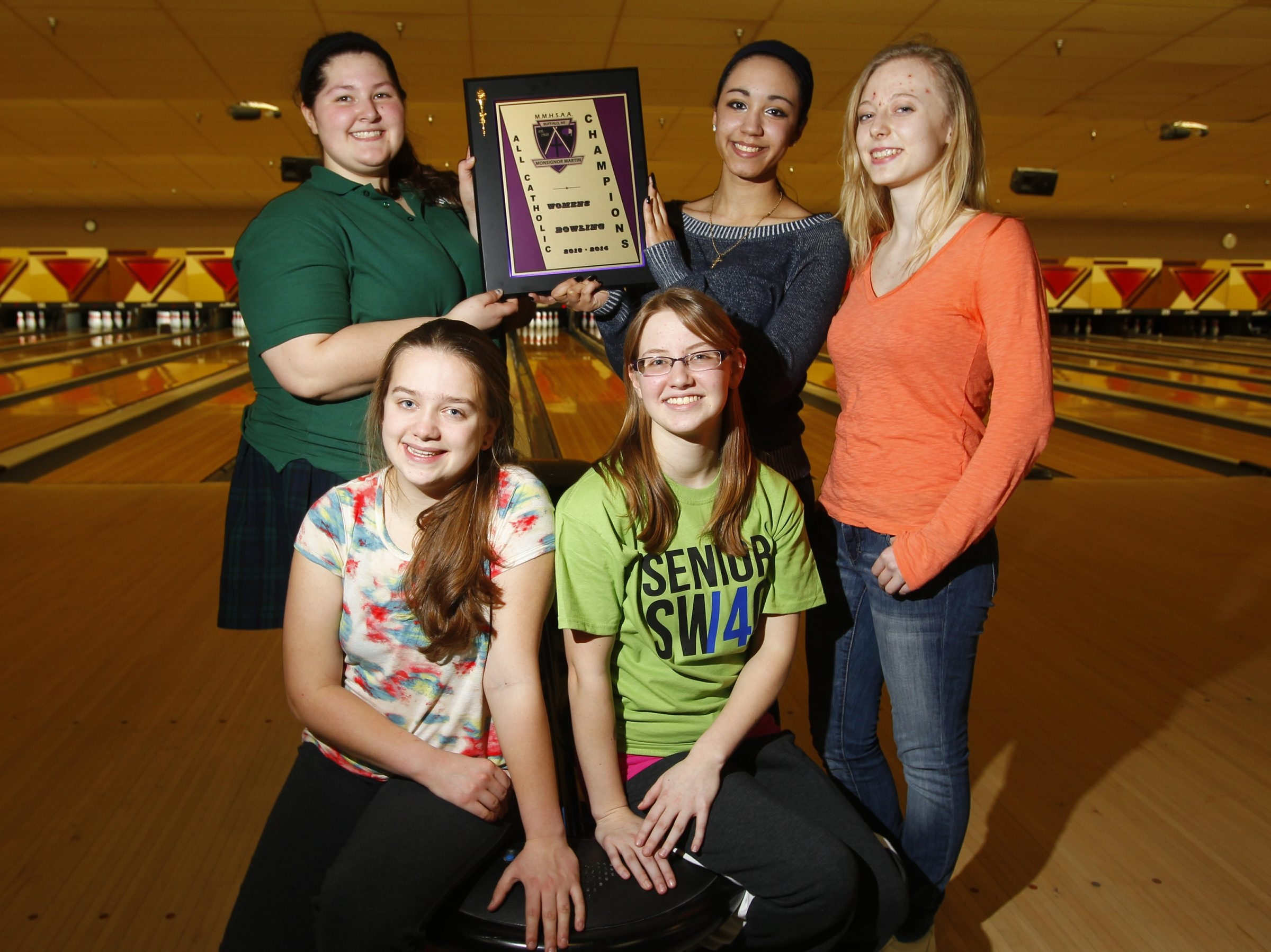 The Mount St. Mary bowling team proudly displays the Monsignor Martin bowling championship award they won Tuesday at AMF Thruway Lanes. In front are Danielle Cunliffe, left, and Caitlin Orgek. Standing, from the left, are: Alexis Greenauer, Catherine Boyd and Jordan Luce.