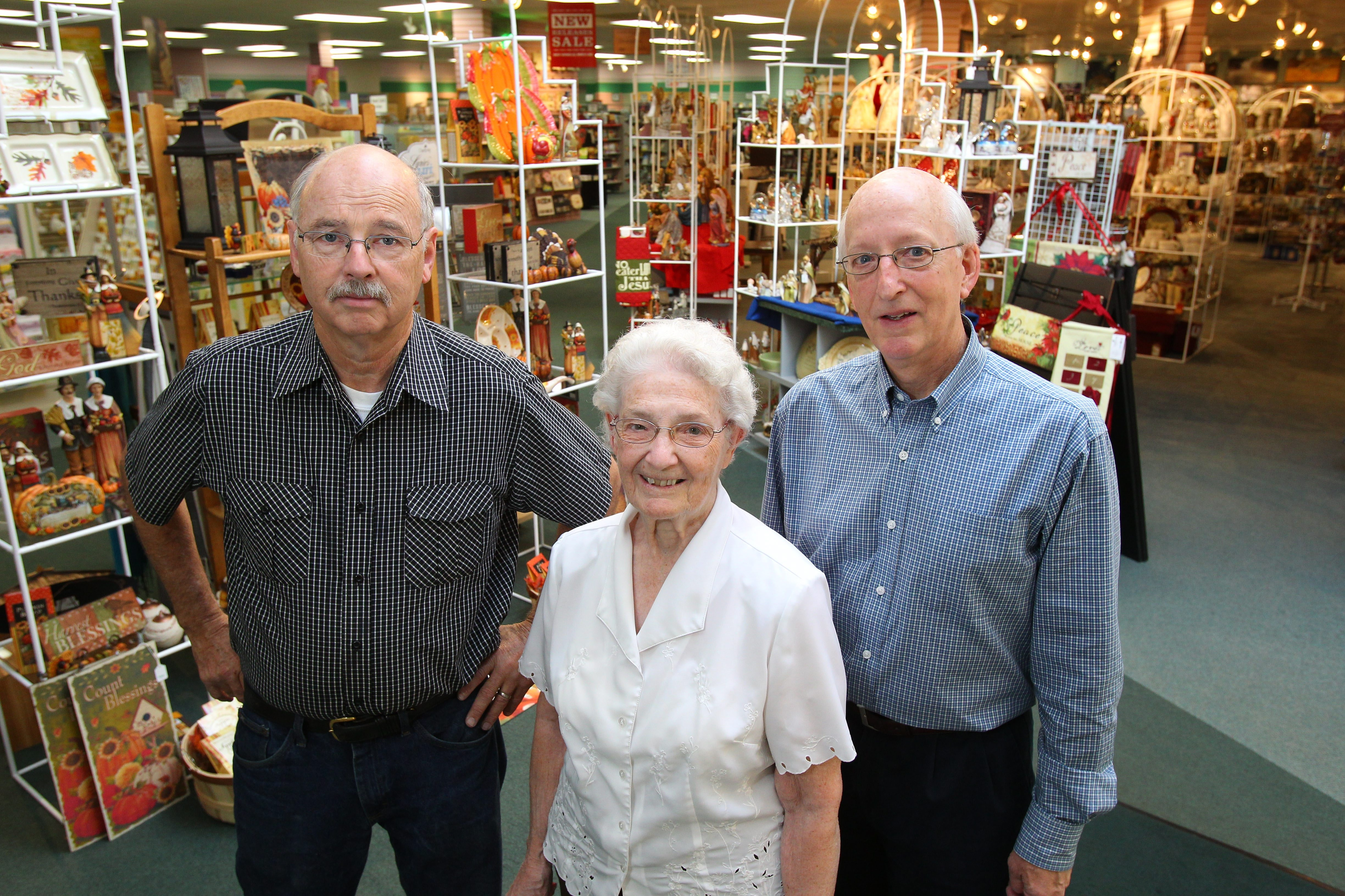 Brain trust of Bender's Parable Christian Store, Clarence – from left, Vice President Ray Slingerland, founder Jean Bender-Mast, President Arden Bender – adapts to changing times with enduring values.
