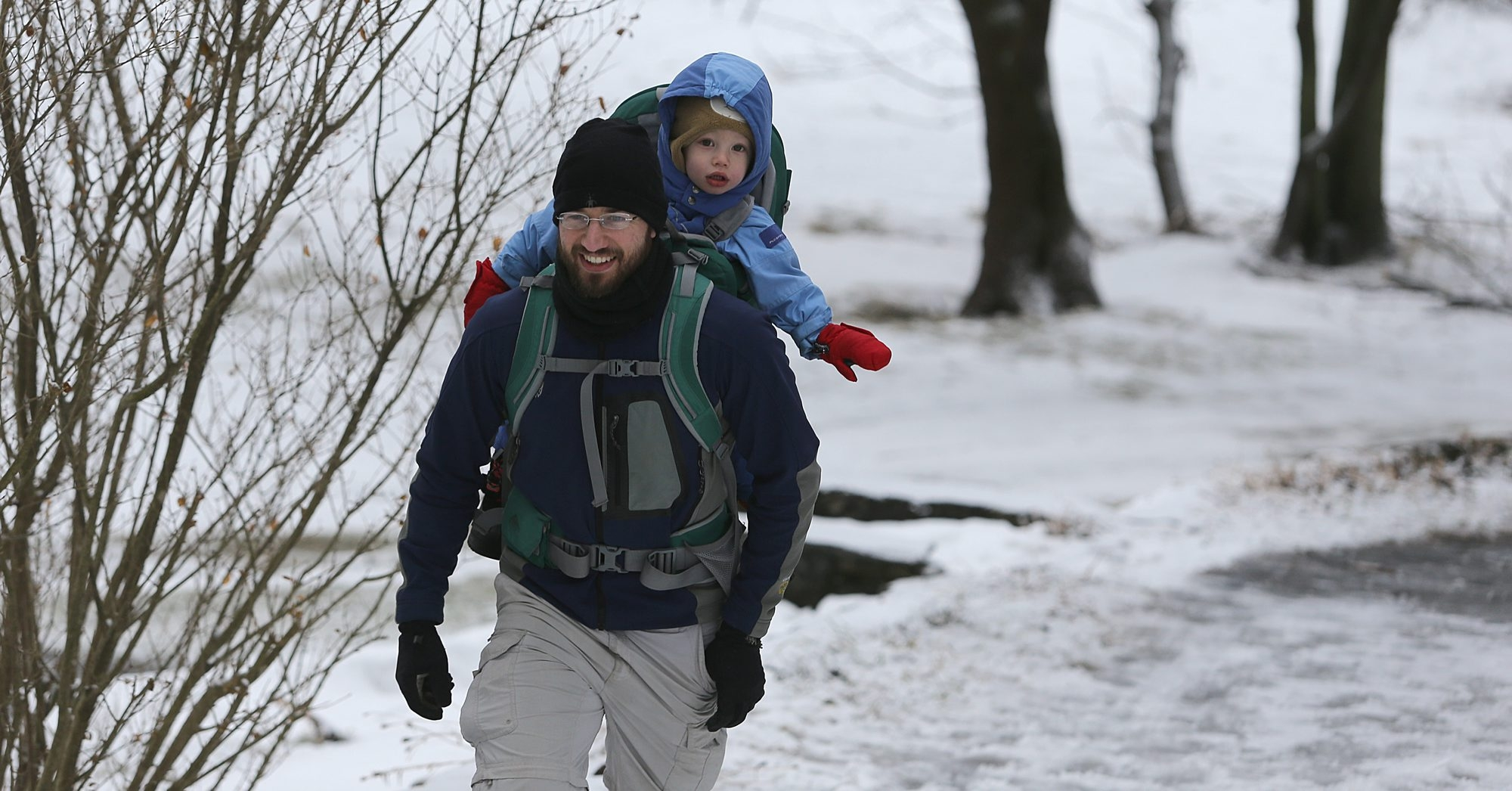 Nathan Kershner and his son, Bryce, 22-months old, go for a hike in Amherst State Park Sunday.