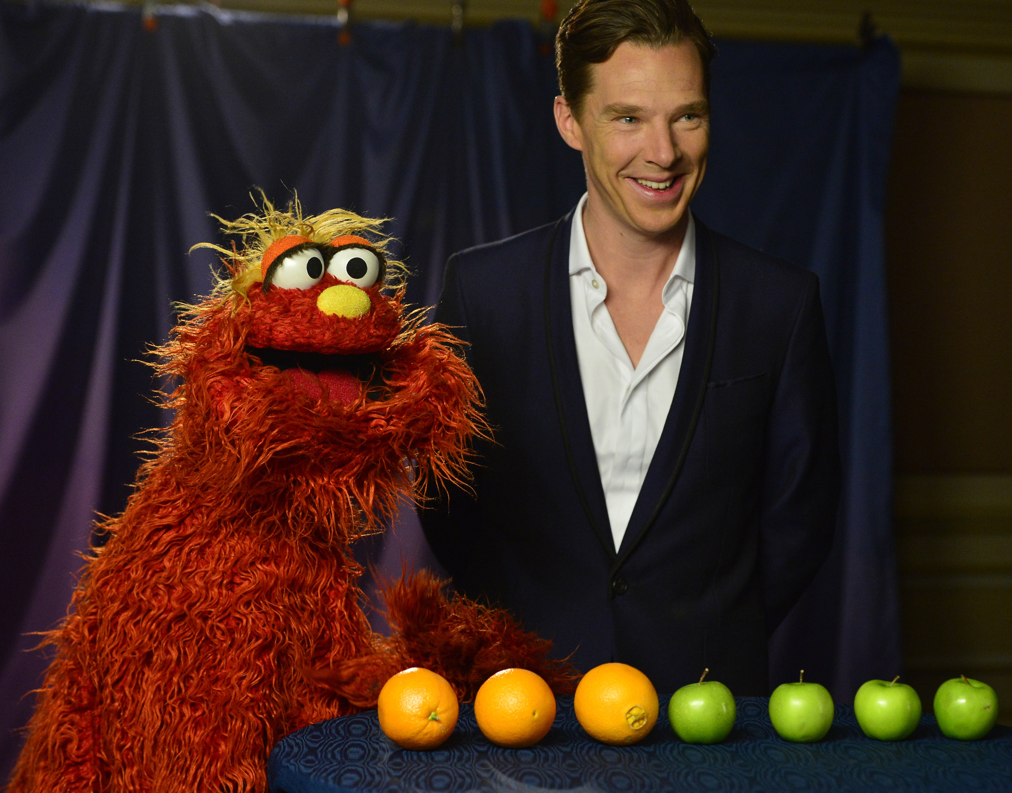 """""""Sesame Street"""" character Murray Monster and actor Benedict Cumberbatch appear in a YouTube video."""