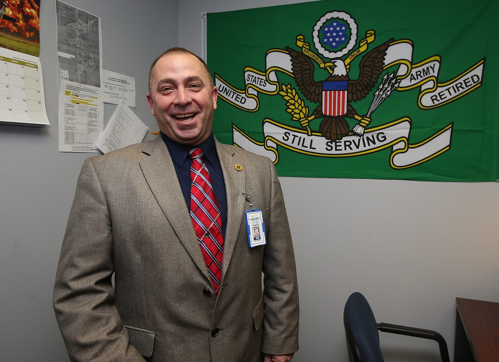 After 23 years in uniform, including two wars, Earl Schmidt serves on home front as Niagara County veterans service officer in Lockport.