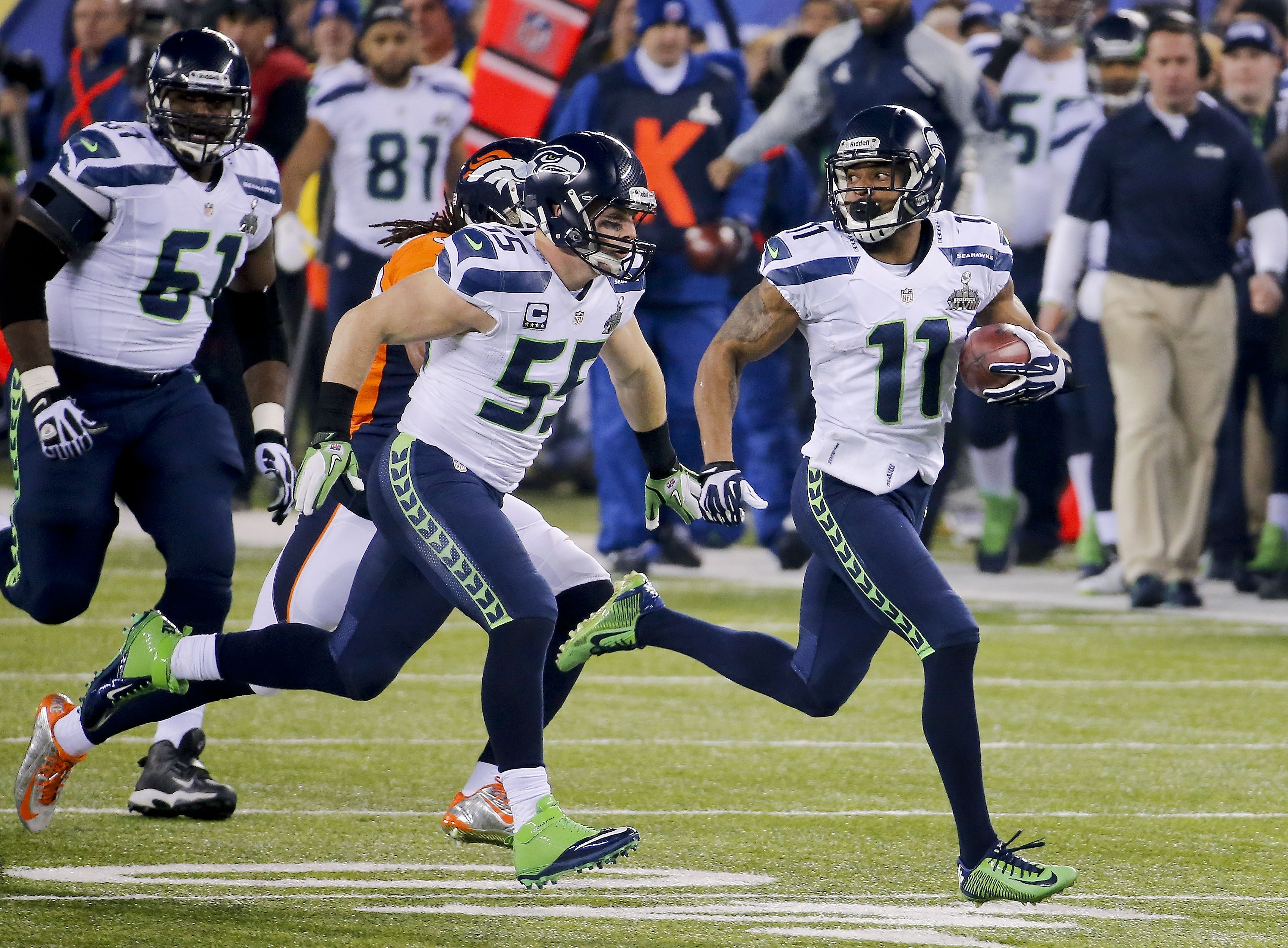 Seattle Seahawks wide receiver Percy Harvin (11) returns a kickoff for a touchdown to open the second half of the Super Bowl against the Broncos, building on Seattle's 22-0 lead en route to the 43-8 triumph at MetLife Stadium in East Rutherford, N.J. (AP Photo/Matt York)