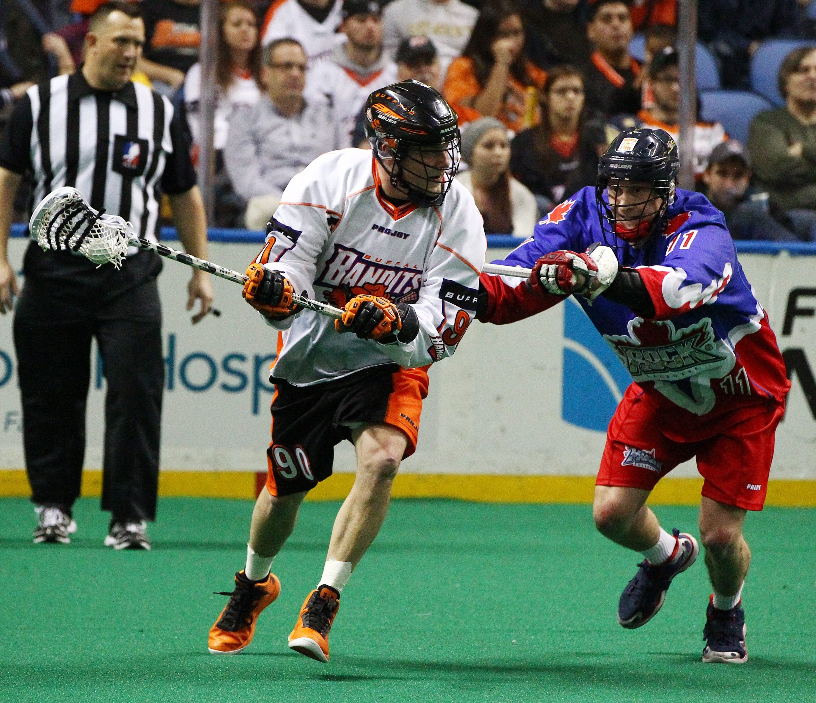 Buffalo's Jamie Rooney works against Toronto's Kyle Belton during first-quarter action at the First Niagara Center.