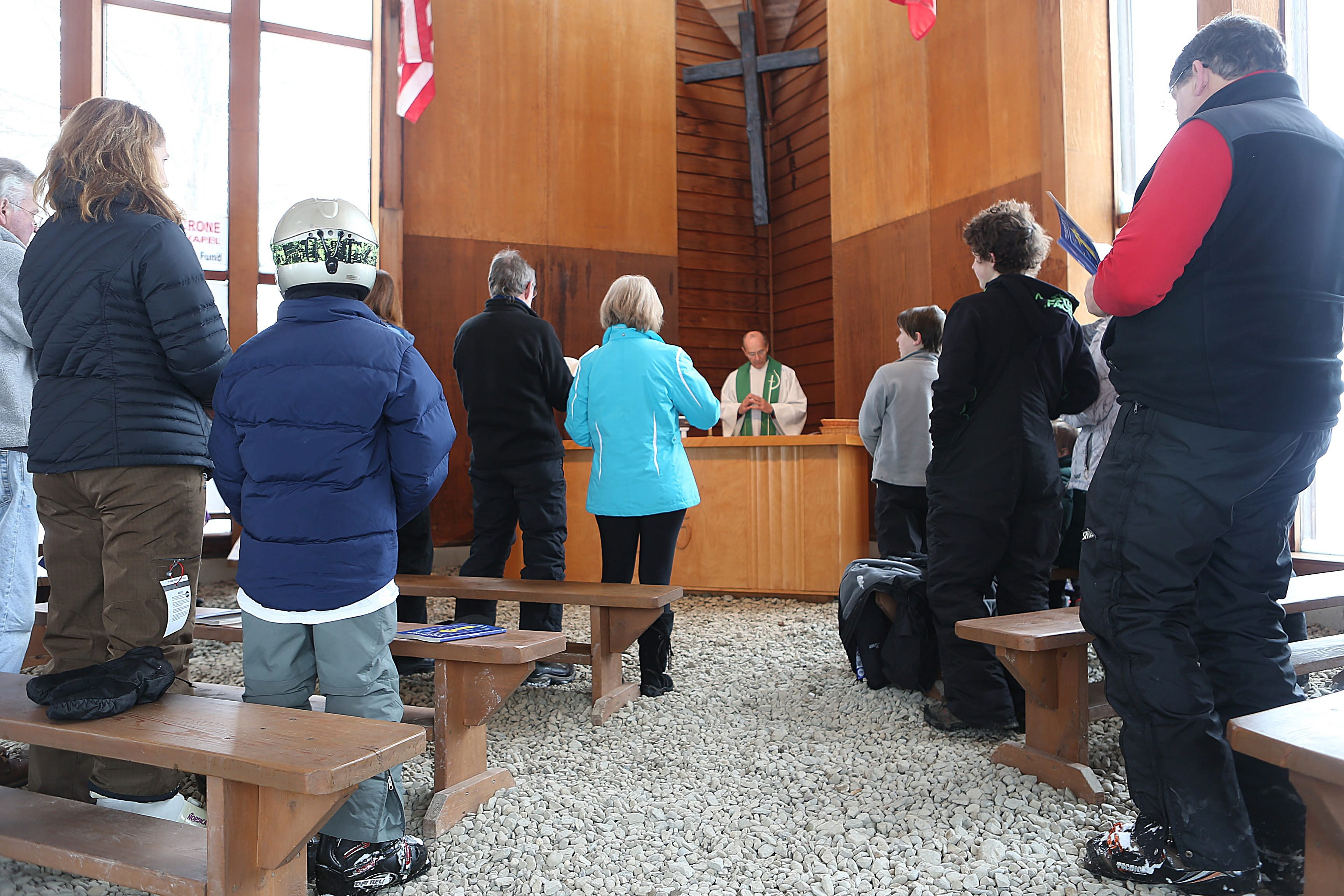 Skiers take a break from near-perfect ski conditions to worship at the Crone Memorial Chapel at Kissing Bridge. Built by members of the Glenwood Acres Ski Club, Mass is held every Sunday from January to early March.