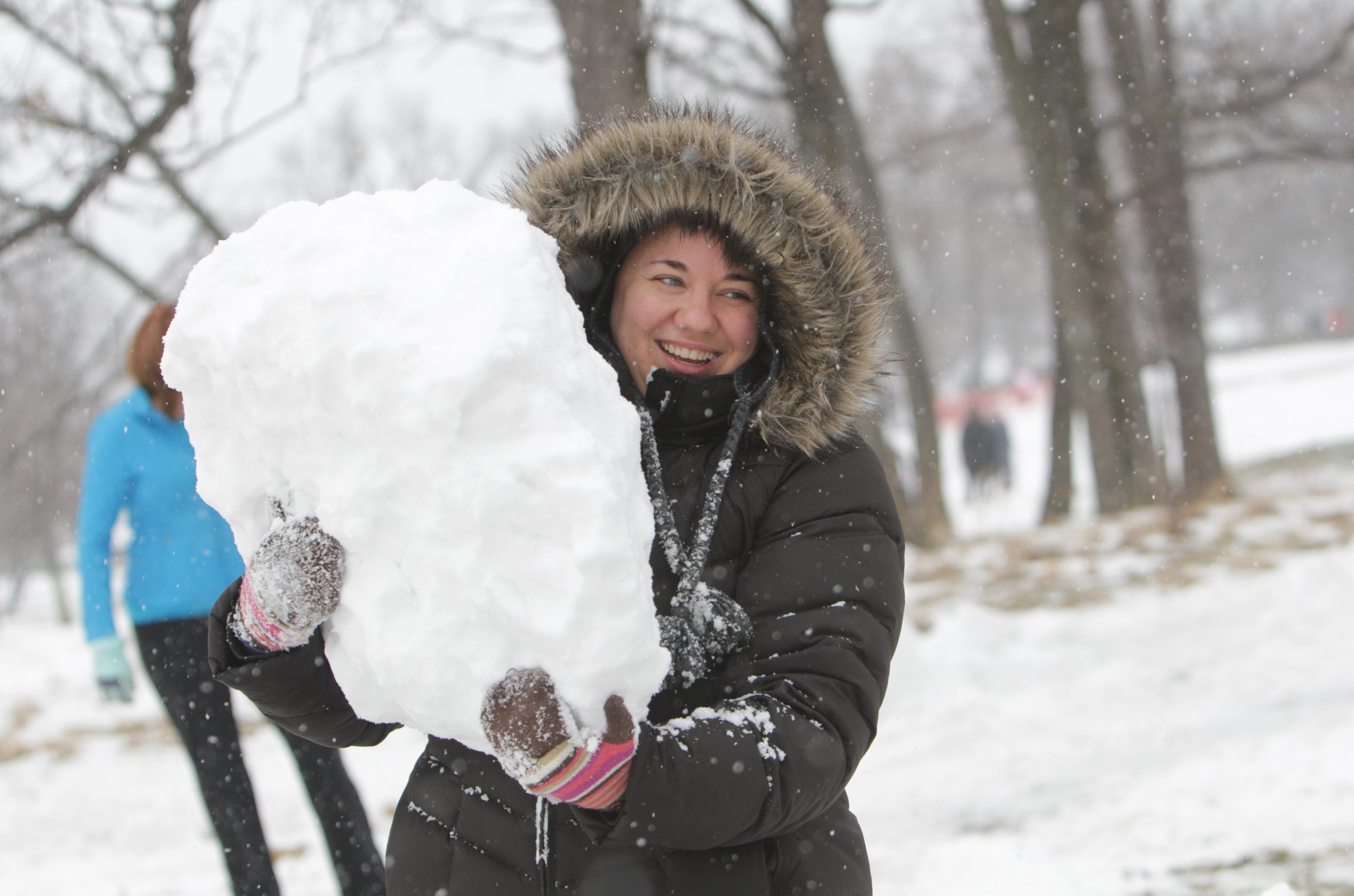Flurrious, the winterfest at Delaware Park, escaped rain and had good weather for all of its snowy activities Saturday.Collen Flynn of Buffalo carries a giant snowball to help her family make a snowman during  BlueCross BlueShield of WNY's snowman contest.  (Sharon Cantillon/Buffalo News)