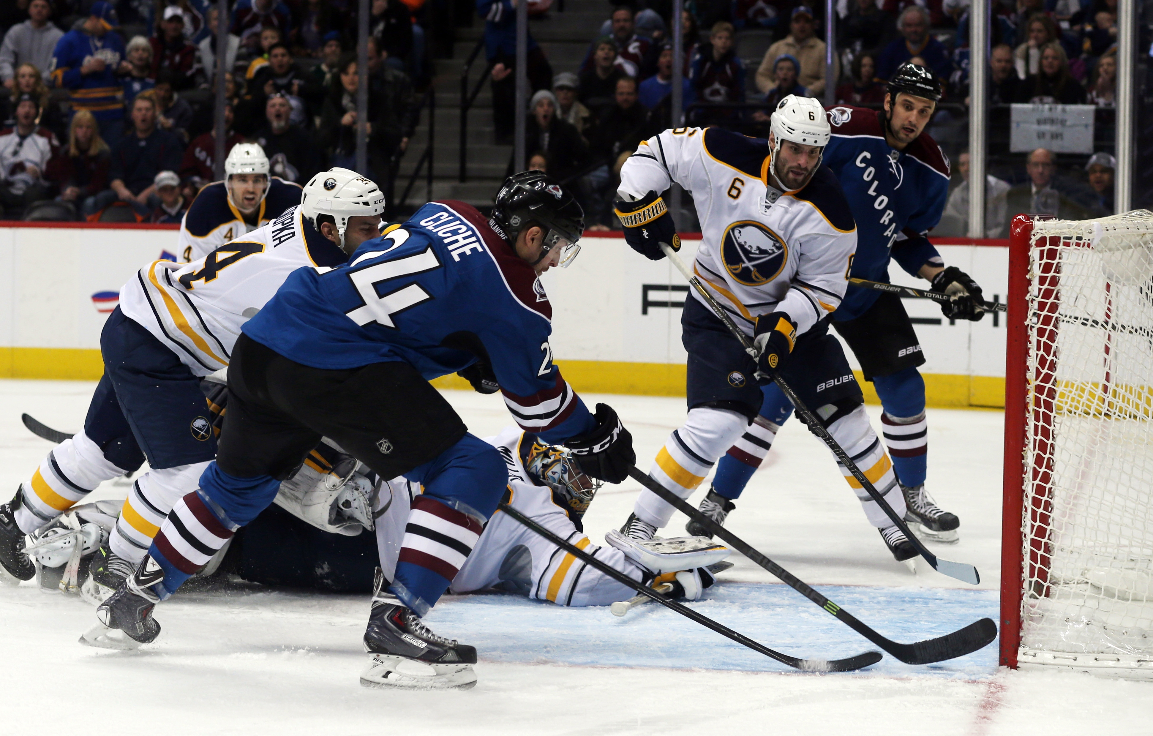 Colorado Avalanche center Marc-Andre Cliche (24) scores the first goal of his NHL career against the Sabres on Saturday in Denver.