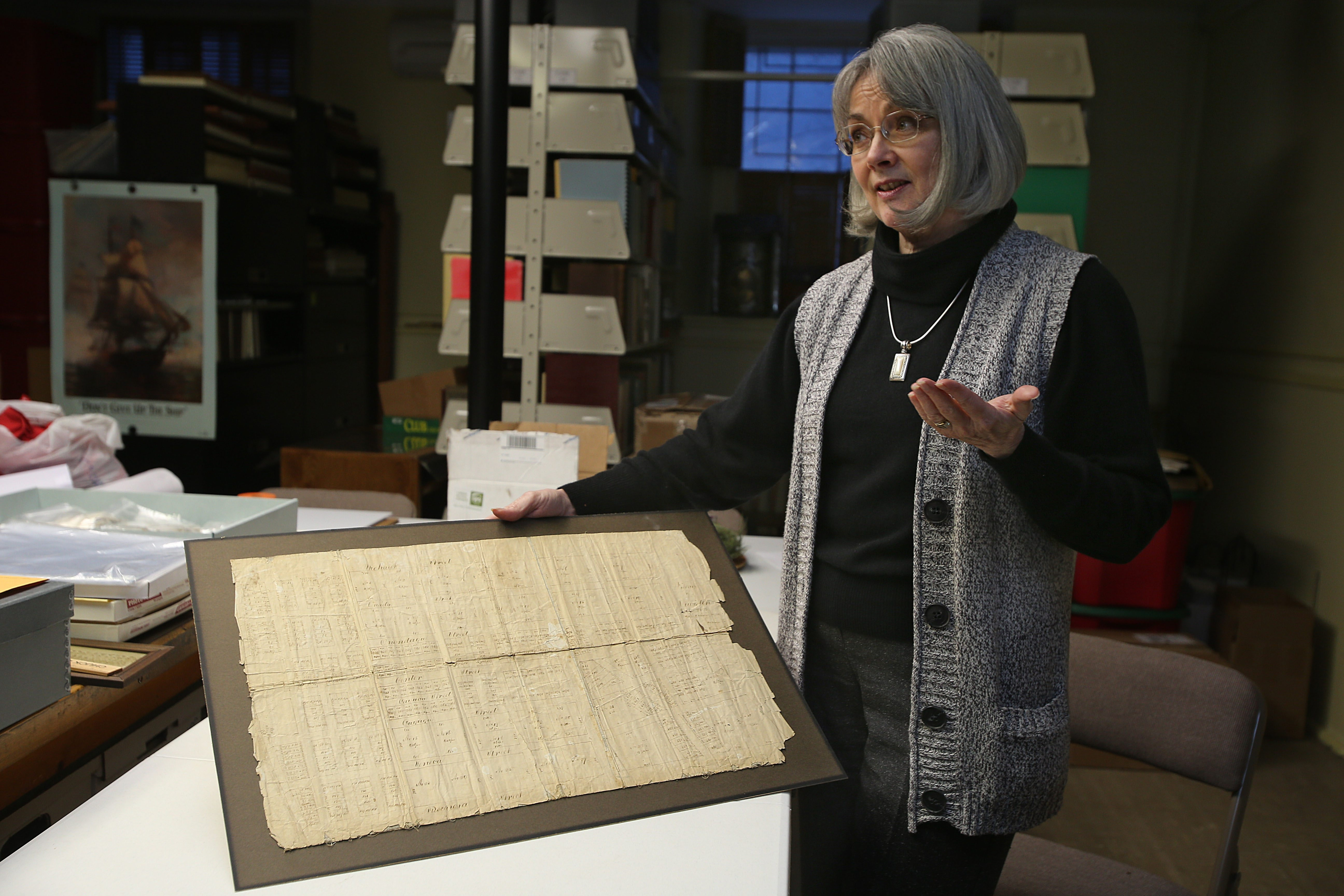 Pam Hauth, executive director of the Historic Association of Lewiston, with an original map of the Village of Lewiston dating back to 1815.