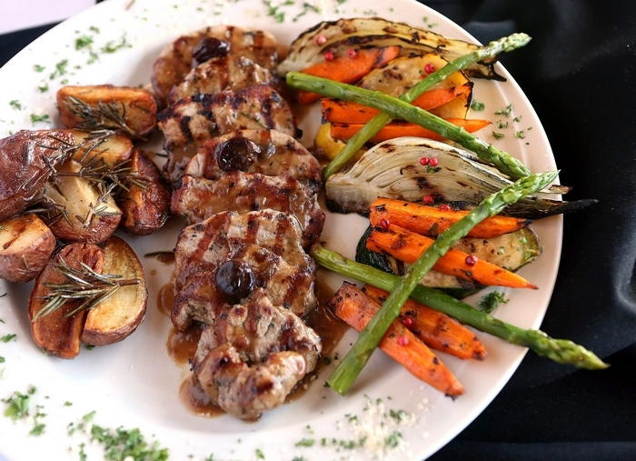 """The grilled wild boar tenderloin dish at San Marco Ristorante is for """"the adventurous person at the table."""" (Robert Kirkham/Buffalo News)"""