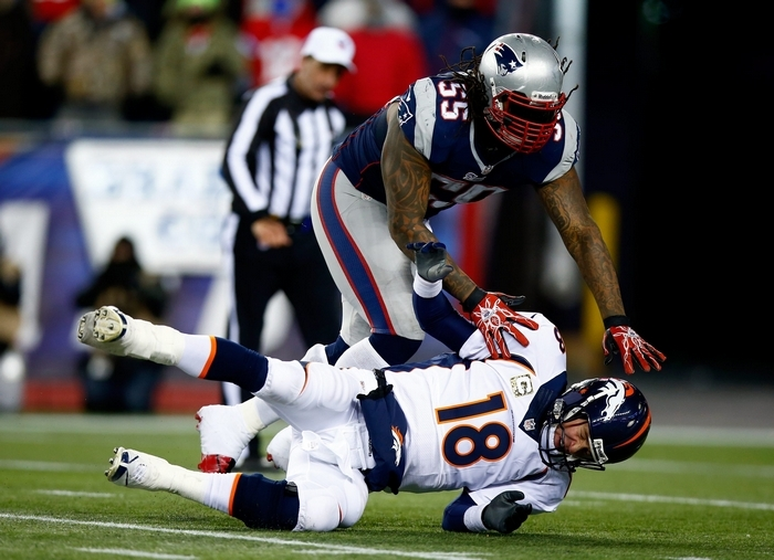 Brandon Spikes, tackling Denver's Peyton Manning, started at linebacker for two seasons with the New England Patriots. (Getty Images)